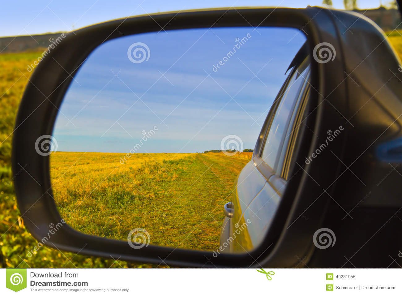 looking out car window with reflection in side mirror
