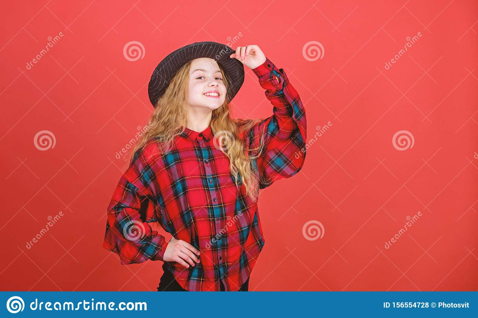 Looking trendy. Little girl with long blond hair in fashion style. Cute little fashion model. Adorable girl with fashion