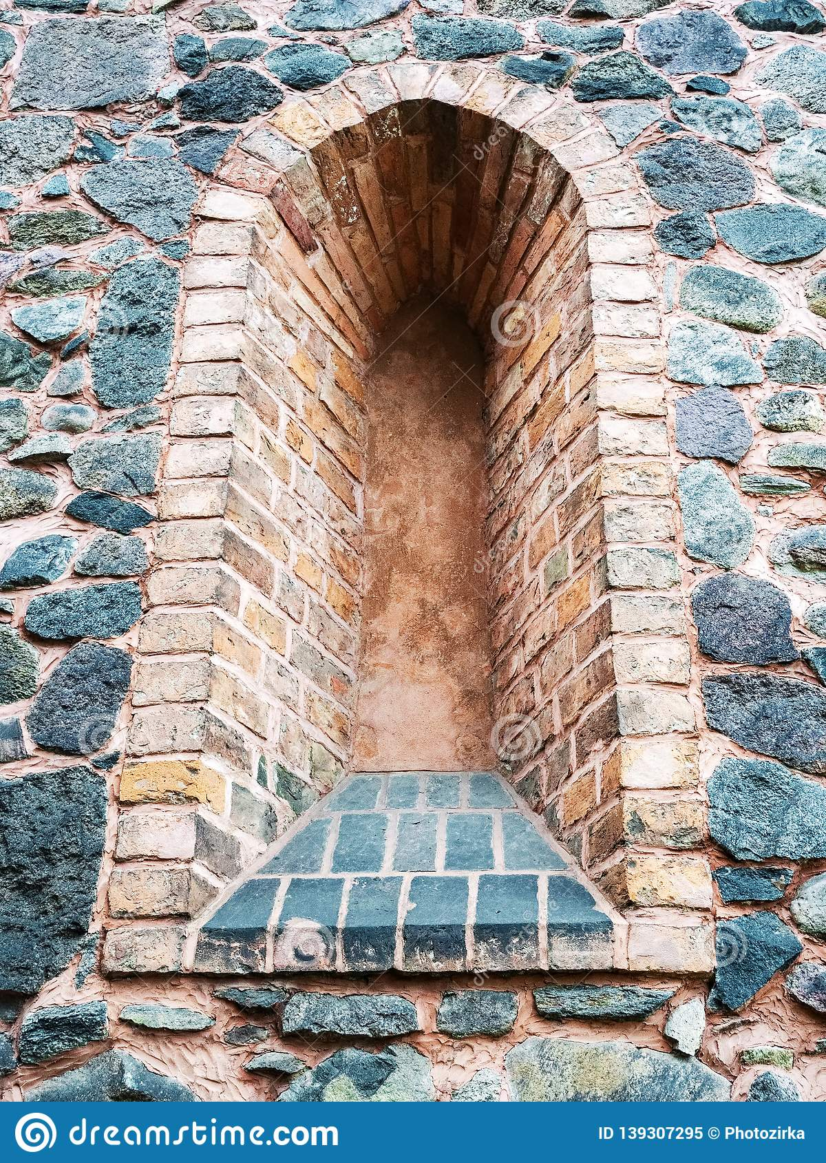 Loophole in wall of medieval castle