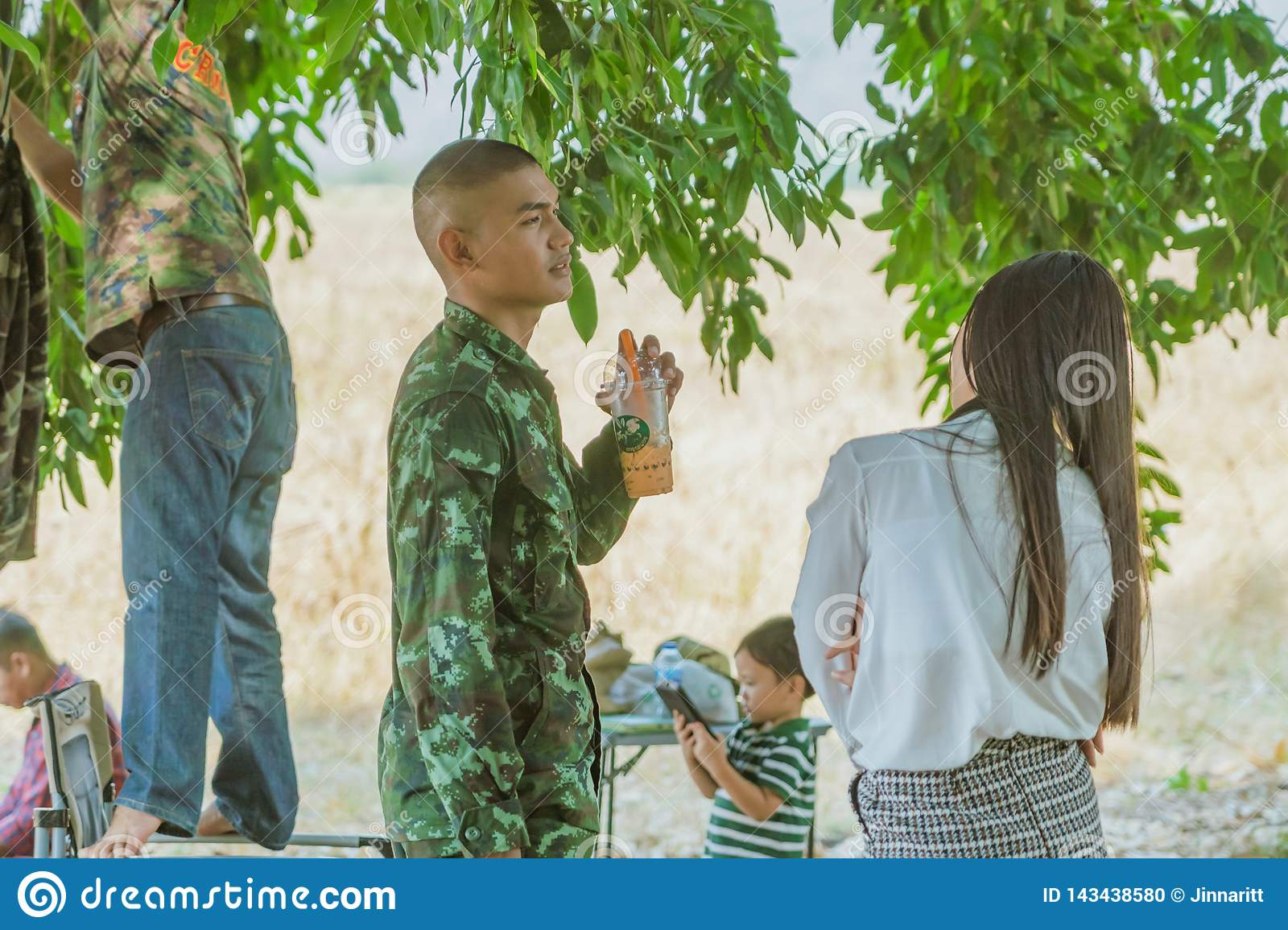 LOPBURI THAILAND, MARCH 23, 2019 : Thai cadets relax after completing the parachute training at Ban Tha Duea Drop Zone on March 23