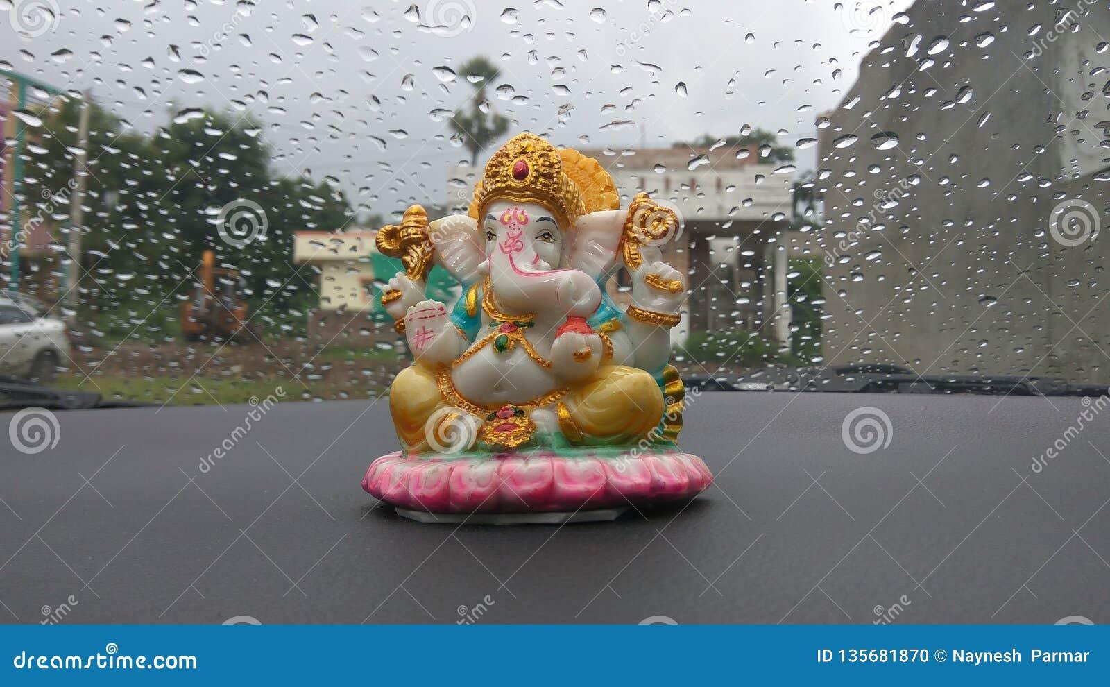 Lord Ganesha Idol In Car With Rain Drew Background Editorial