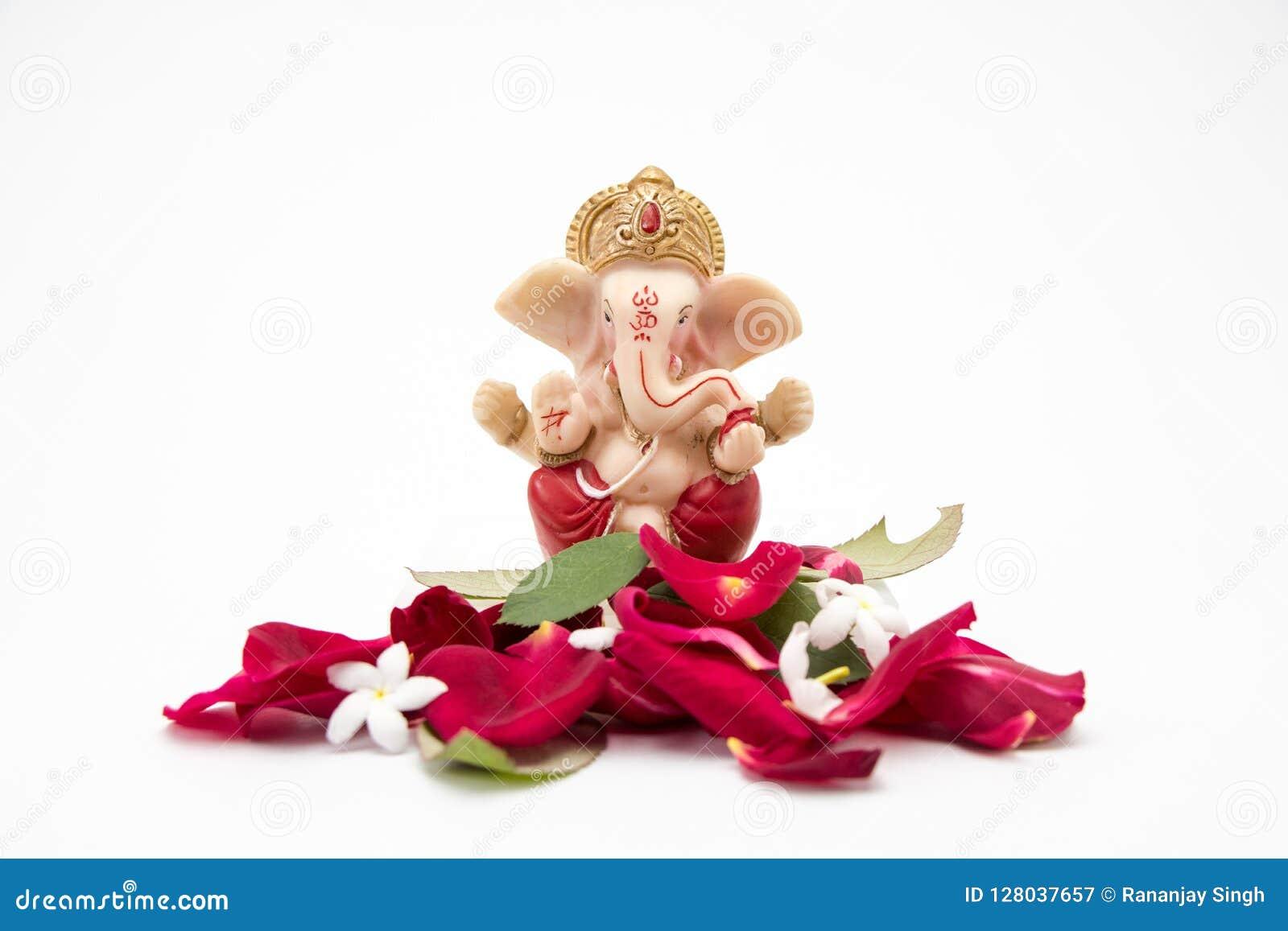 Lord Ganesha Idol With Rose Petals On White Background Ganesh Chaurthi Ganesh Pooja Stock Image Image Of Hindu Religion 128037657