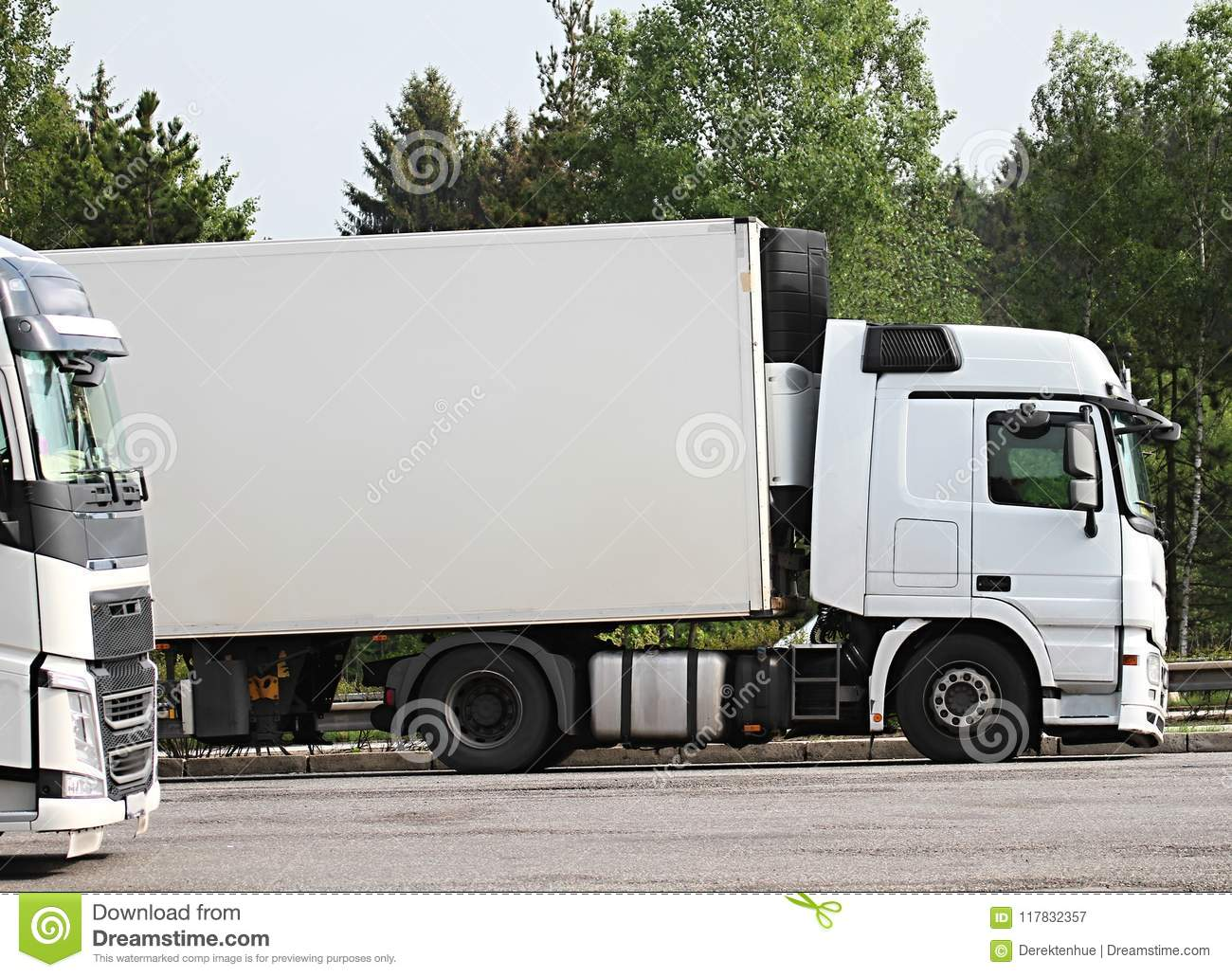 Lorries parked up outside a company`s car parking area