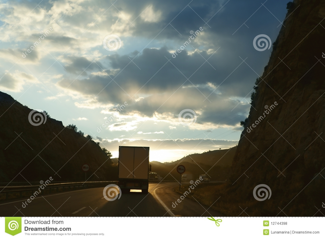 Lorry truck backlight on a golden Europe road