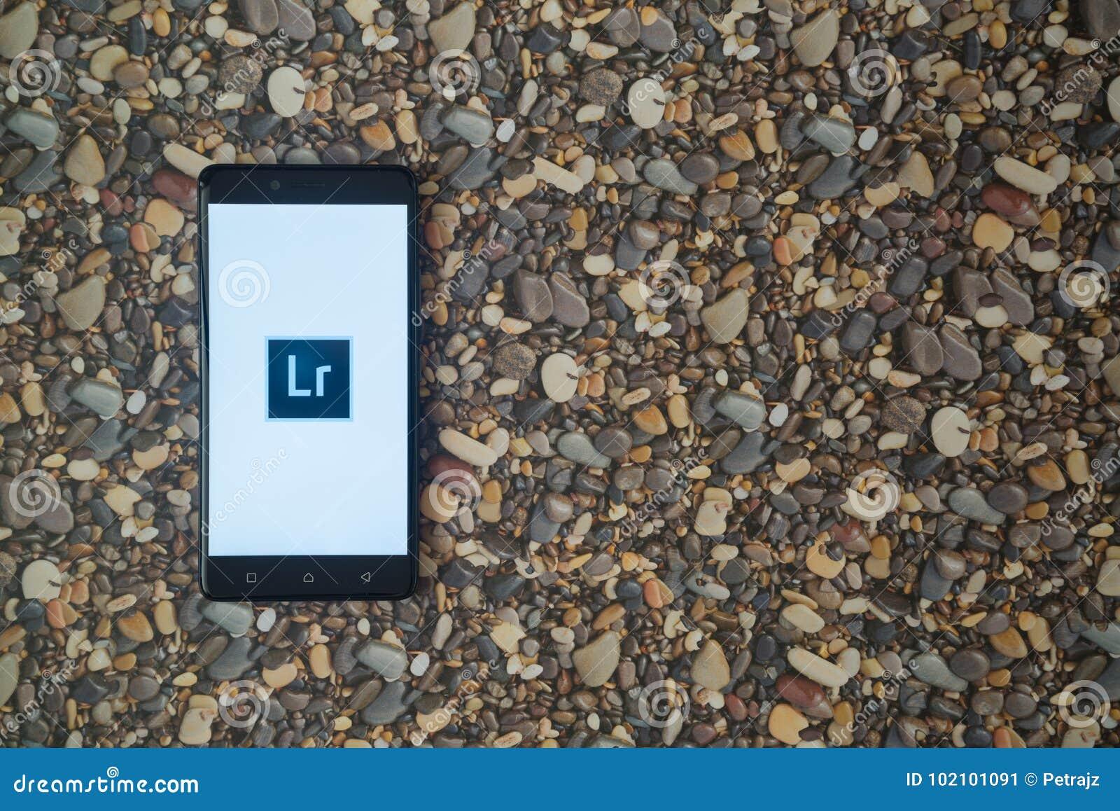 Adobe Photoshop Lightroom Logo On Smartphone On Background Of Small