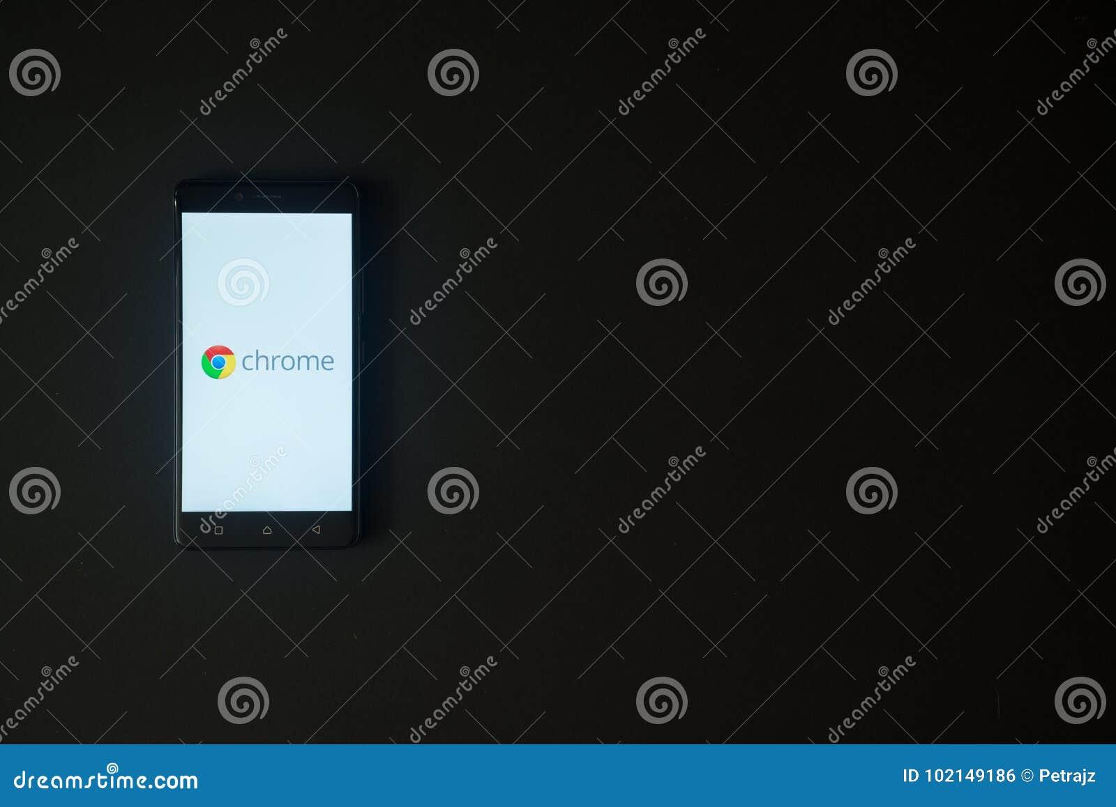 Google Chrome Logo On Smartphone Screen On Black Background