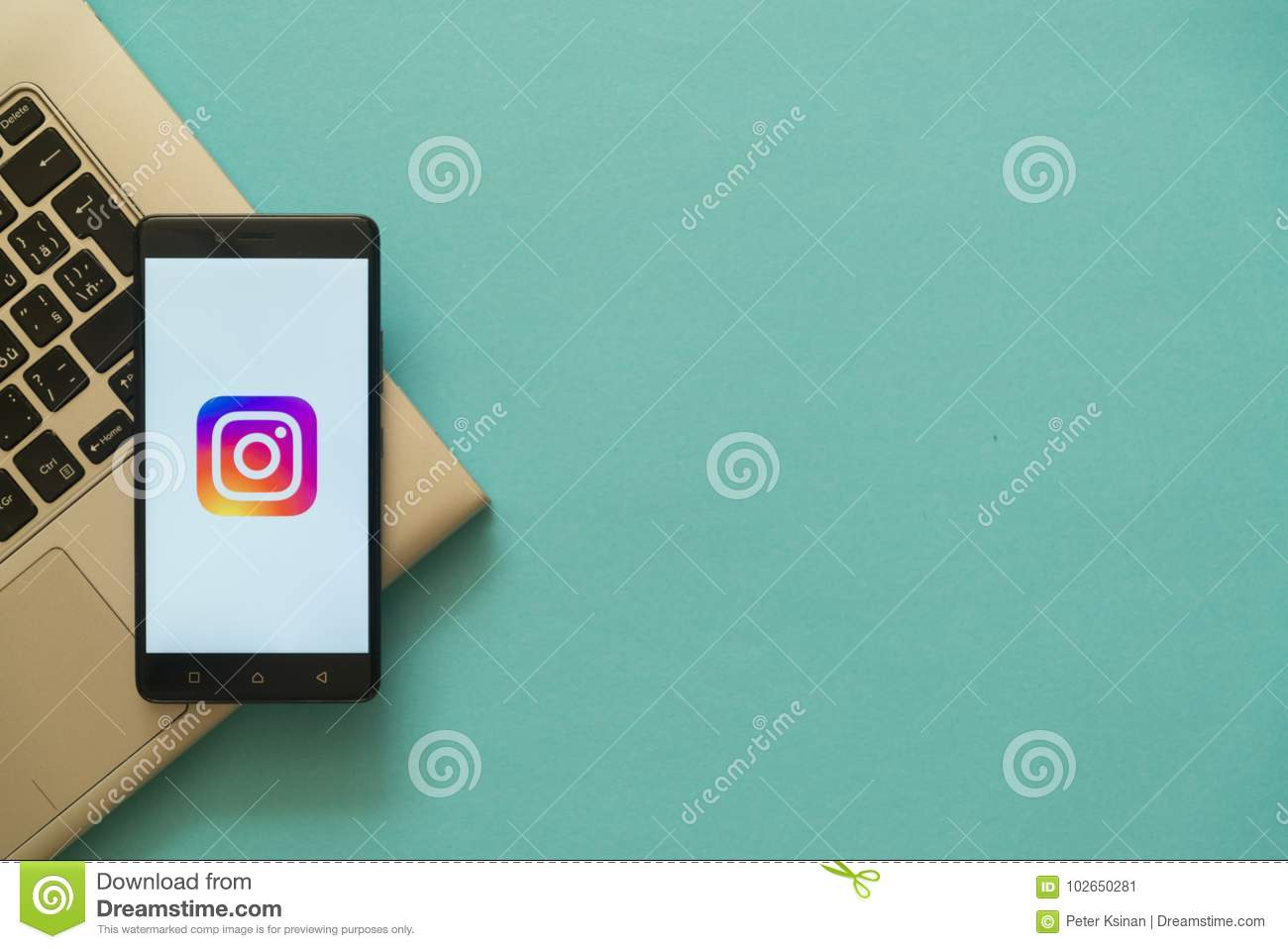 Instagram Logo On Smartphone Placed On Laptop Keyboard  Editorial