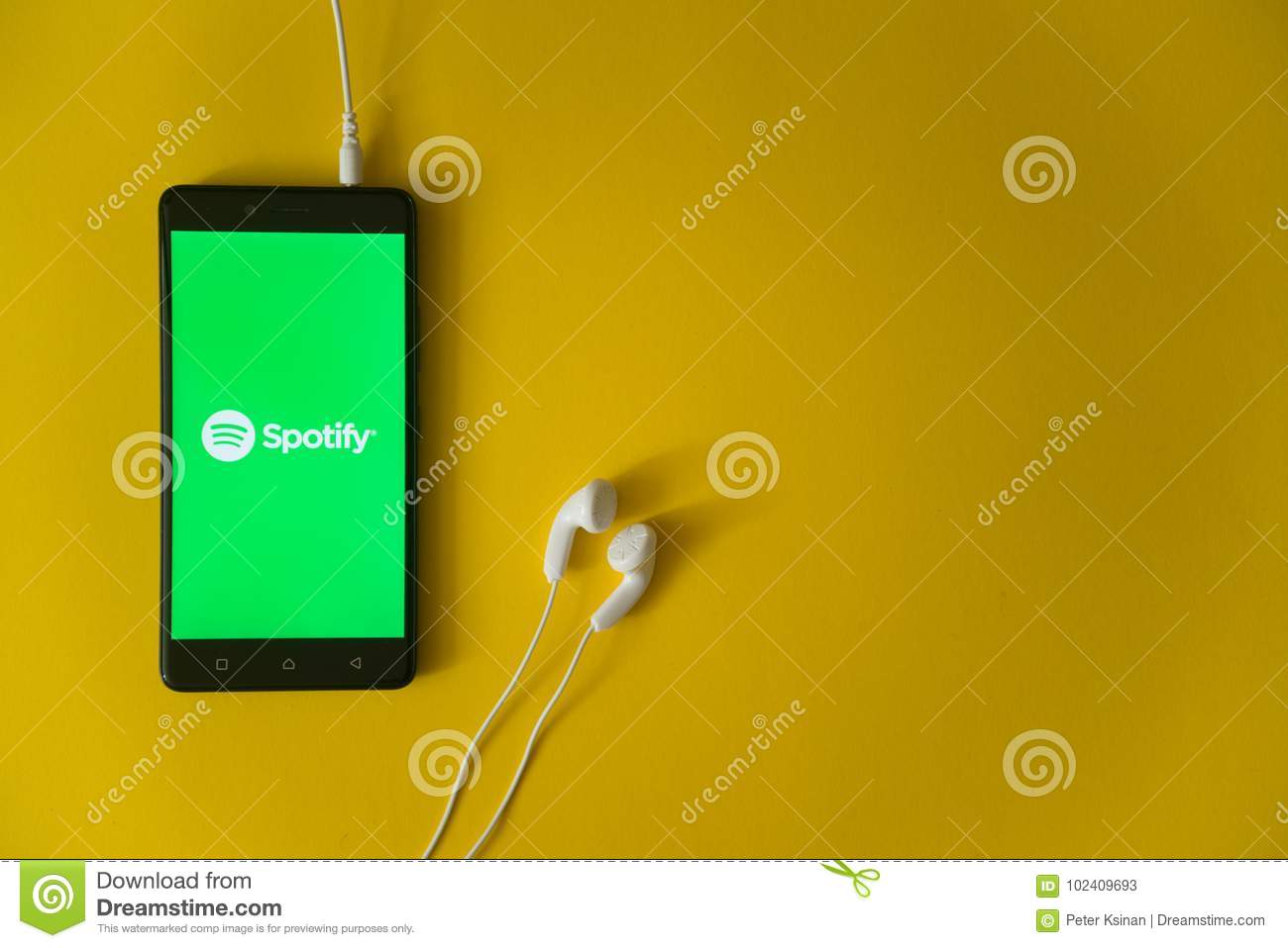 Spotify Logo On Smartphone Screen On Yellow Background Editorial