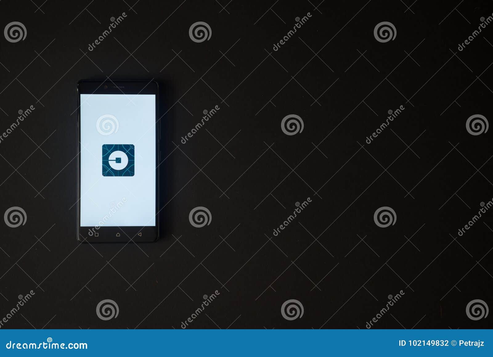Uber logo on smartphone screen on black background editorial uber logo on smartphone screen on black background icon modern editorial stock photo buycottarizona