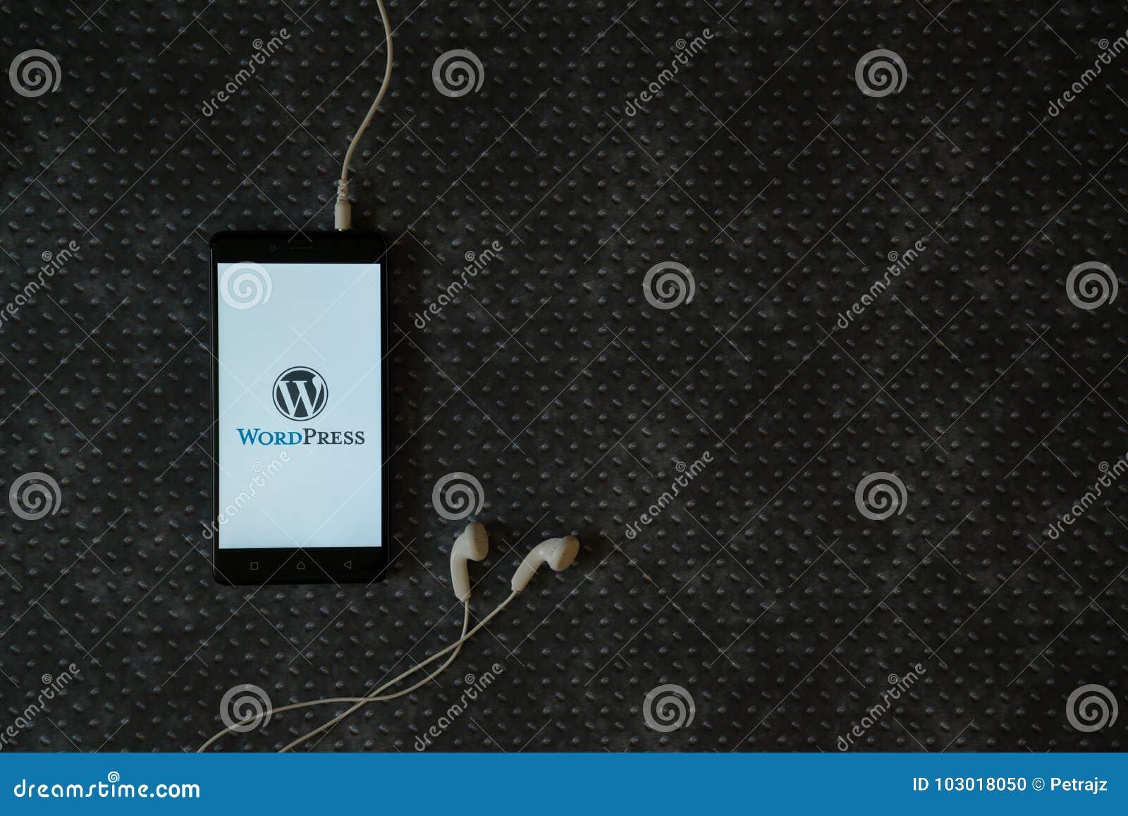 wordpress logo on smartphone screen editorial image