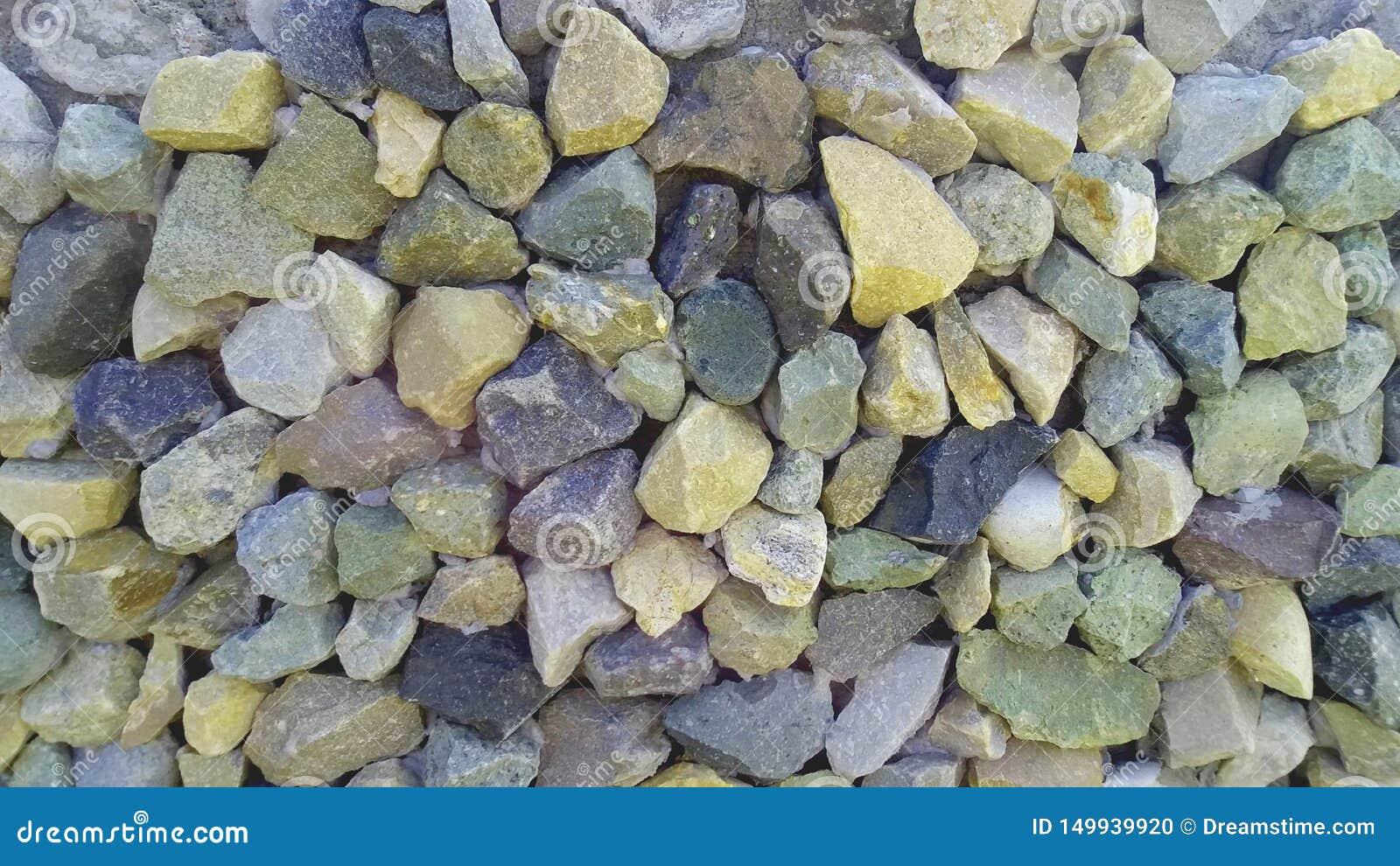 Los guijarros de las piedras cubren con grava piedras machacadas