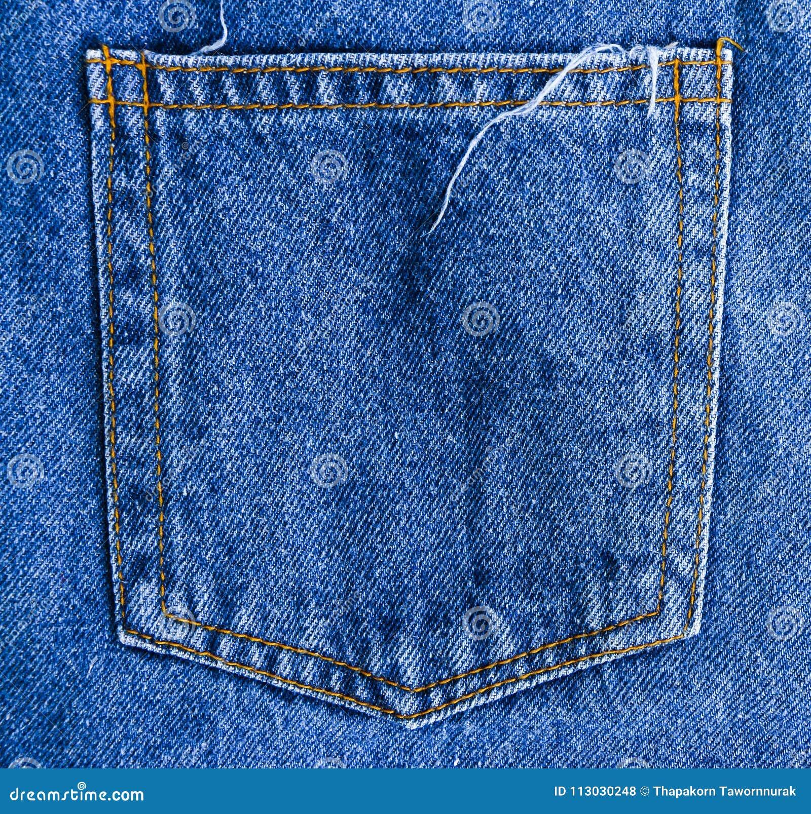 Los tejanos apoyan el fondo de la textura del bolsillo