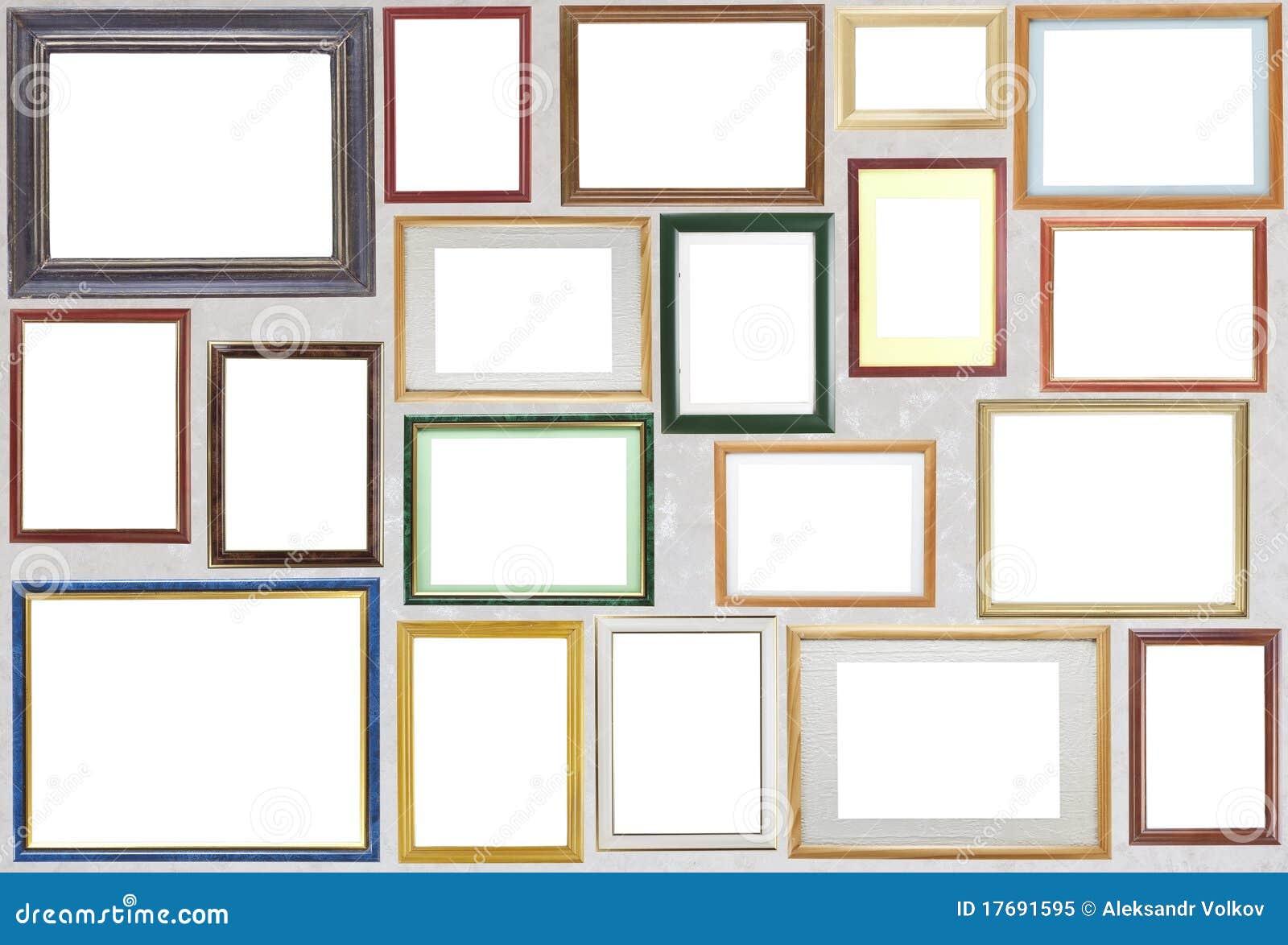 Los varios marcos de madera de la foto cuelgan en una - Fotos en la pared ...
