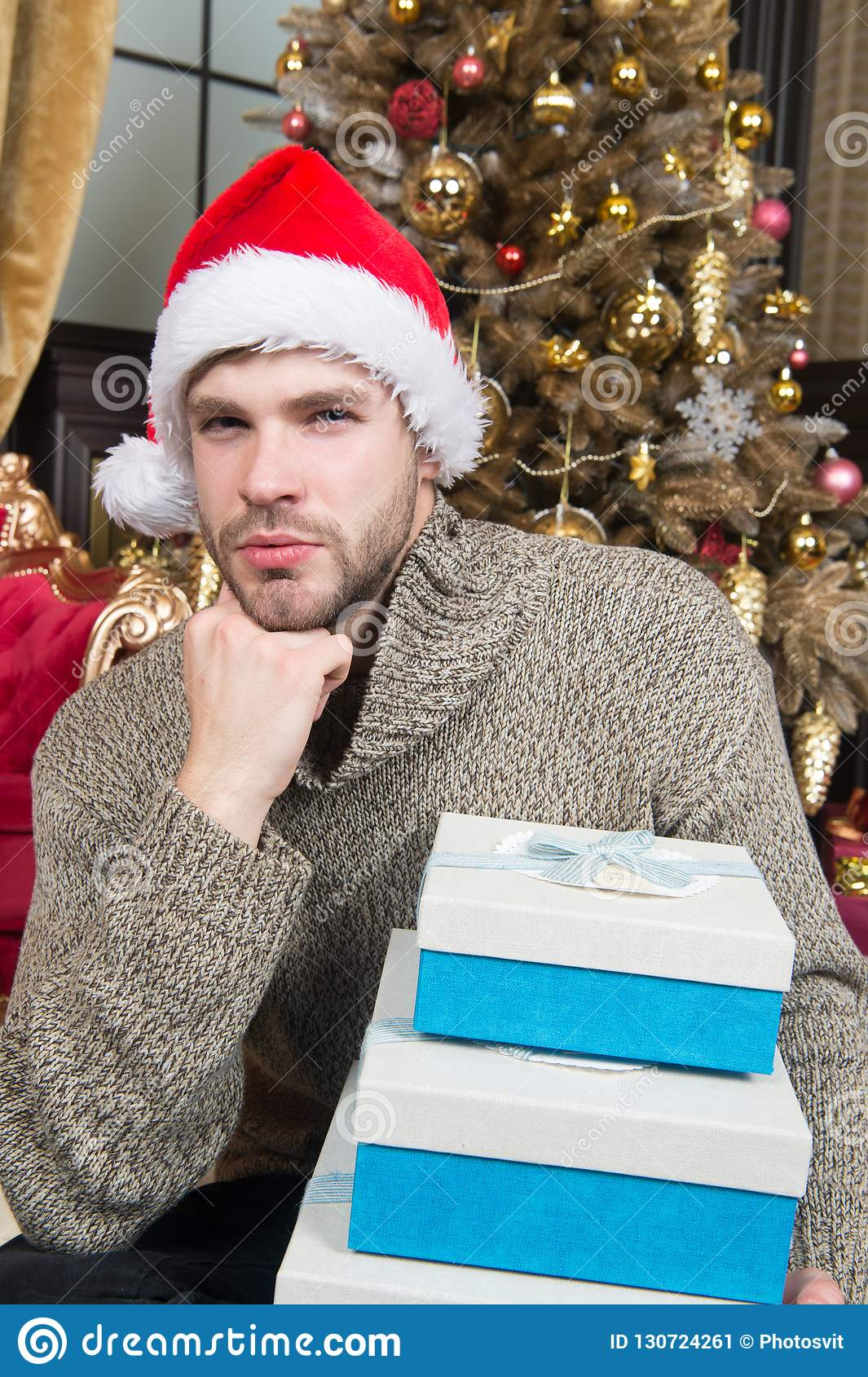 Christmas Thoughts.Lost In Christmas Thoughts Happy Man With Xmas Gift Boxes