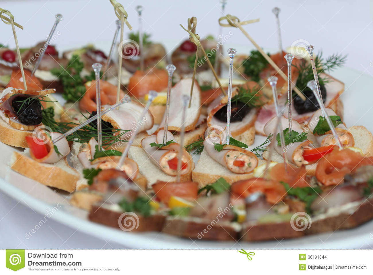 Canapes with skewers and sandwiches stock images image for Canape wraps