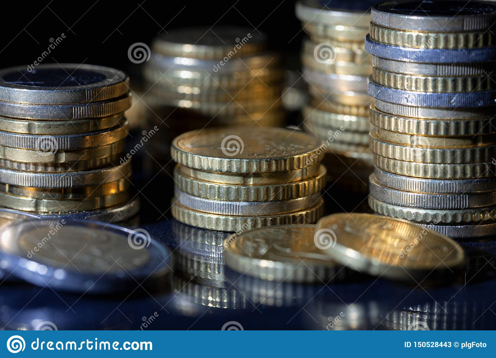 A lot of euro coins and cents on black