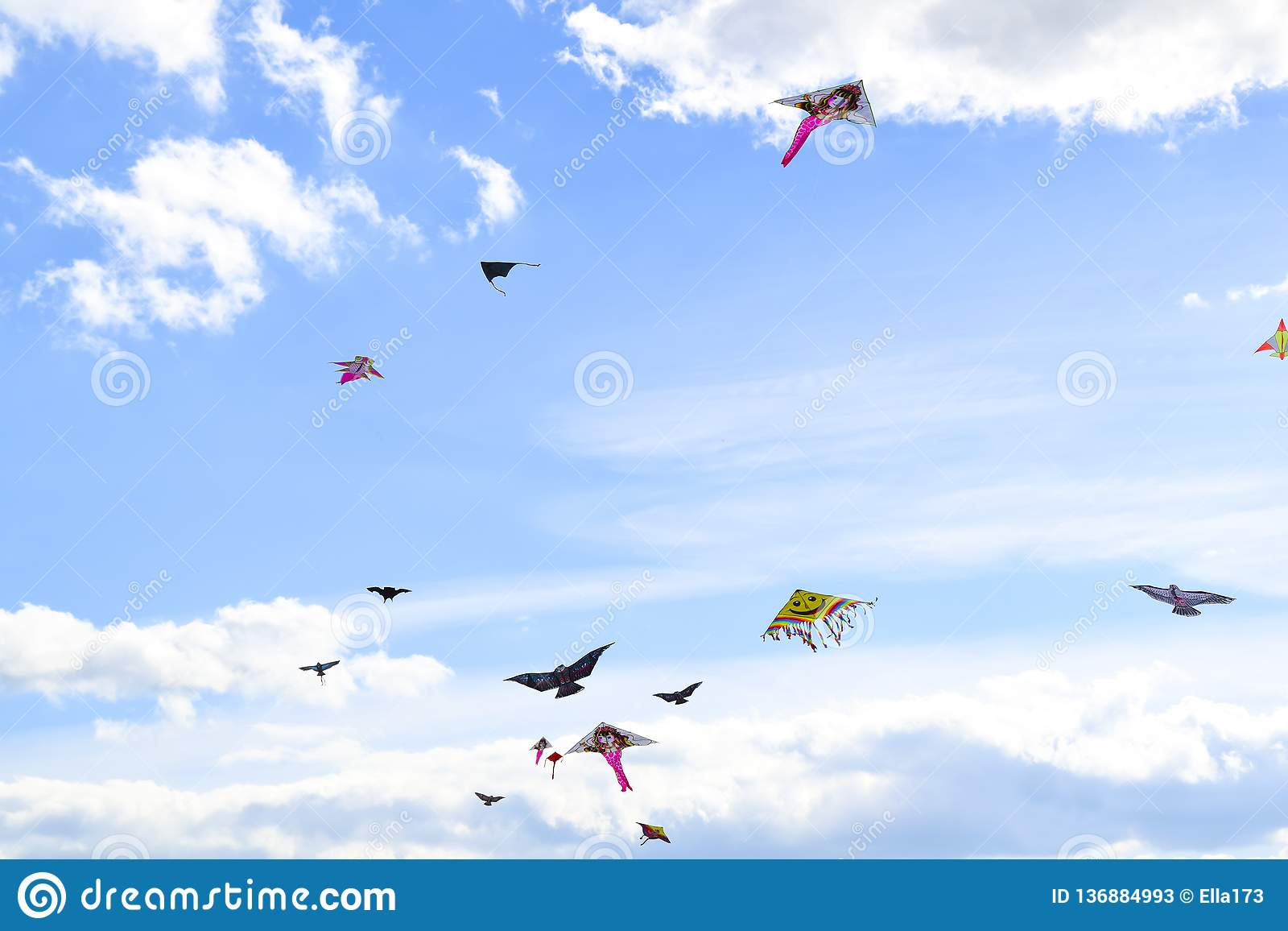 Lot of multi-colored kites in the sky vertical background