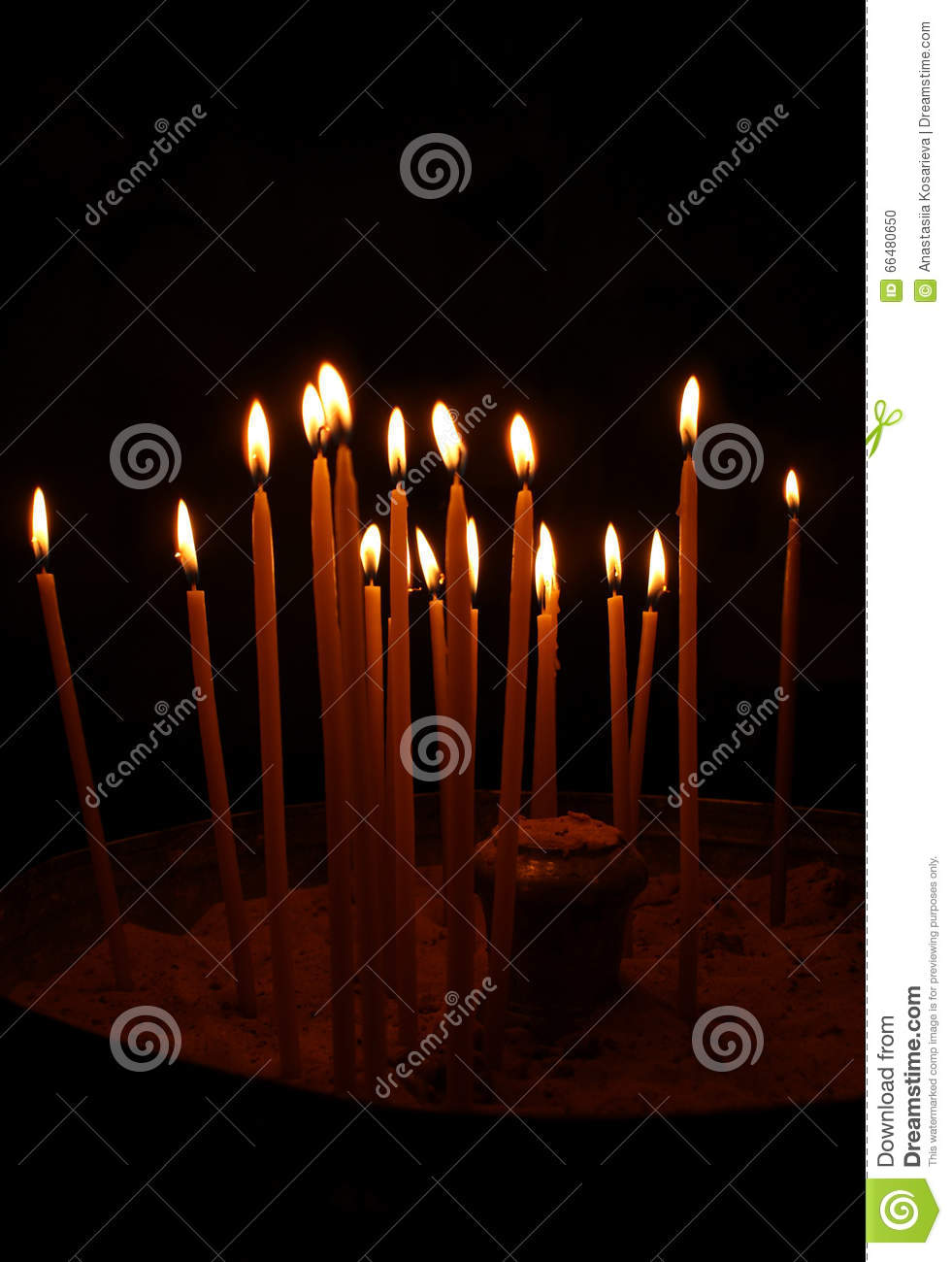 A lot oflighted candles in the dark