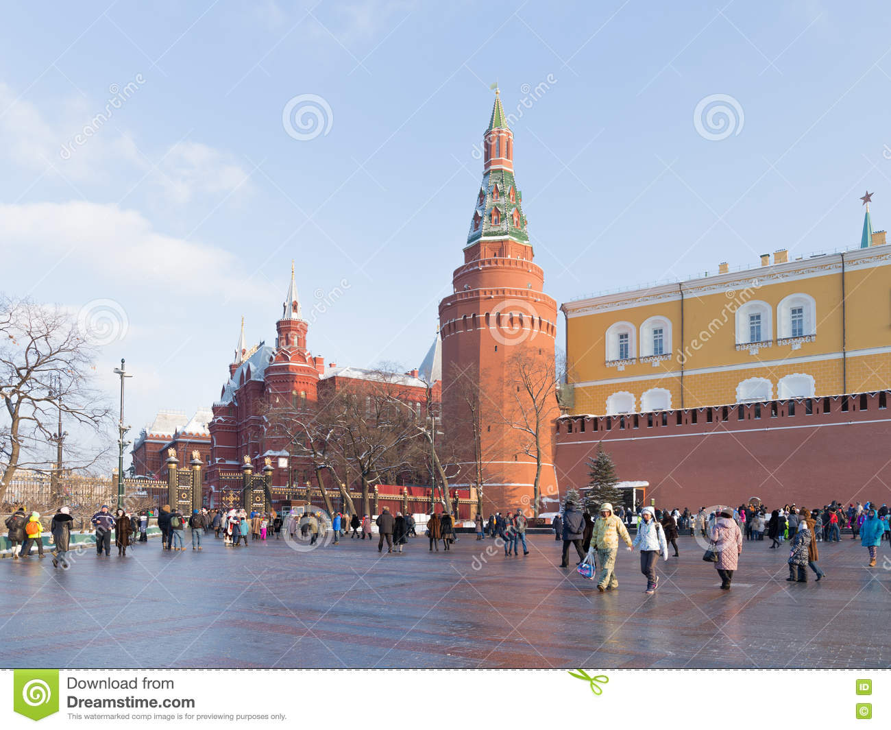 a lot of people walk around the kremlin walls editorial photo