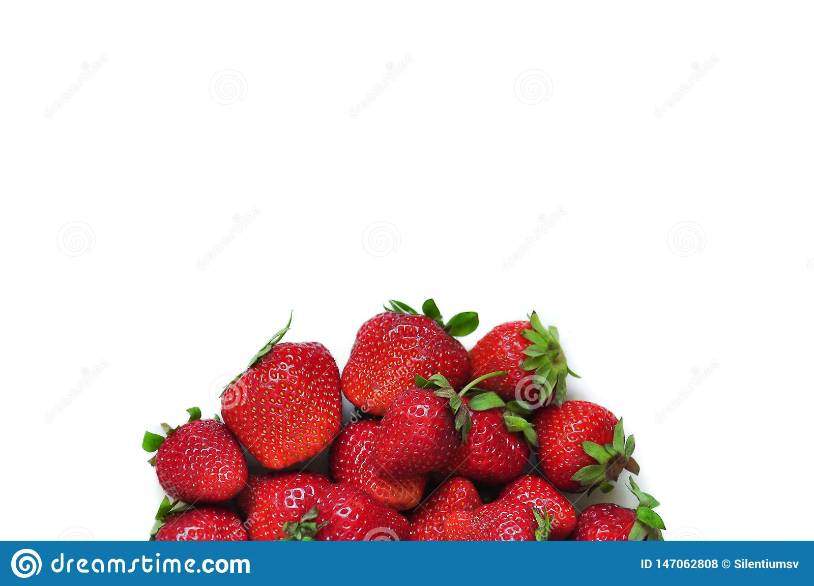 A lot of strawberry berries on a white background. A group of sweet fruits. Vitamin fruits for smoothies, cocktails and preserves.