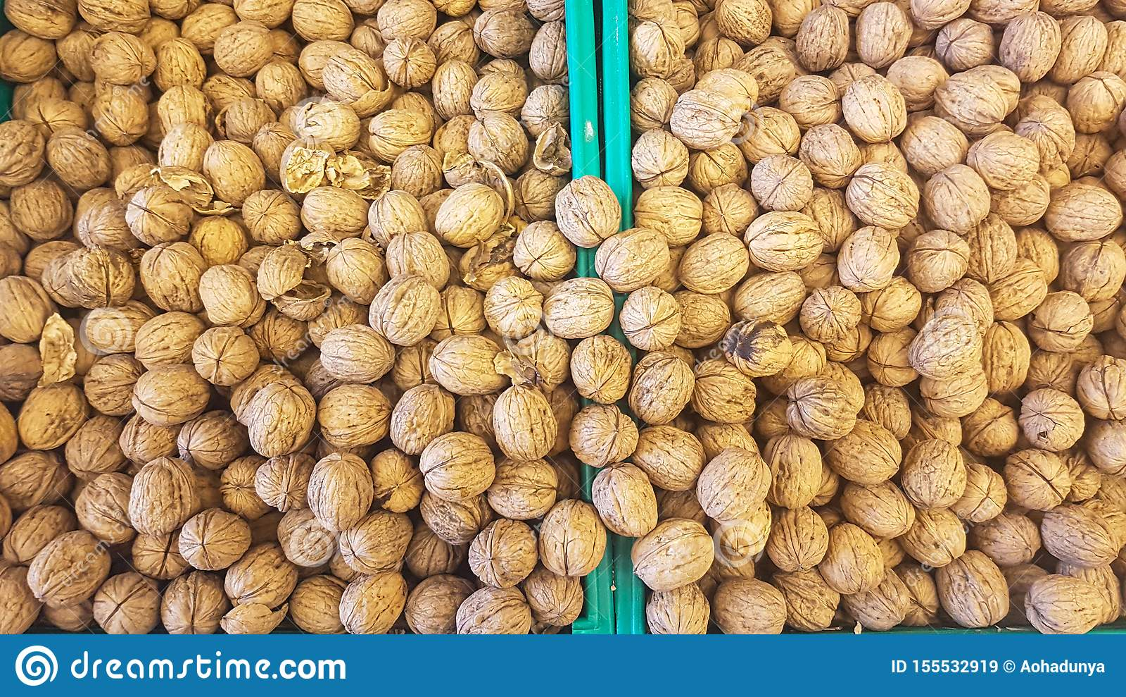 Brown inshell walnuts in the fresh vegan market