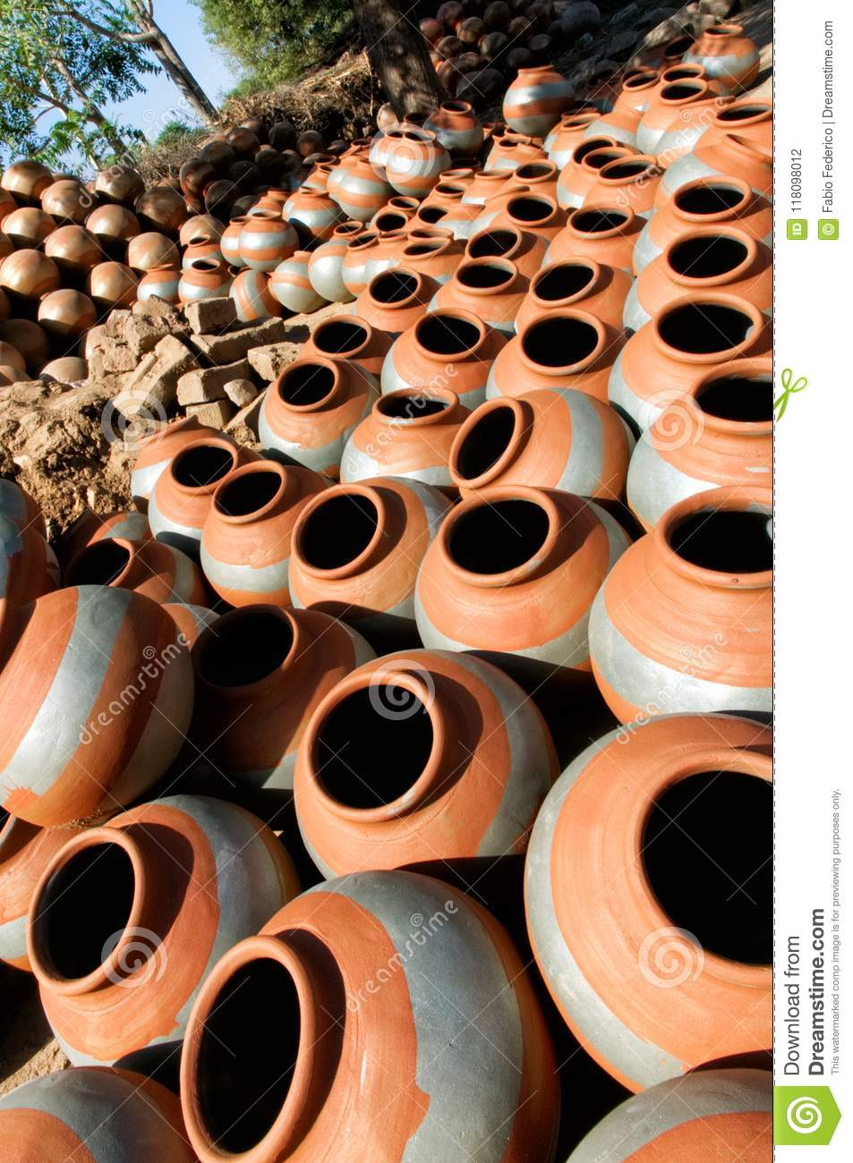 Round clay pots drying