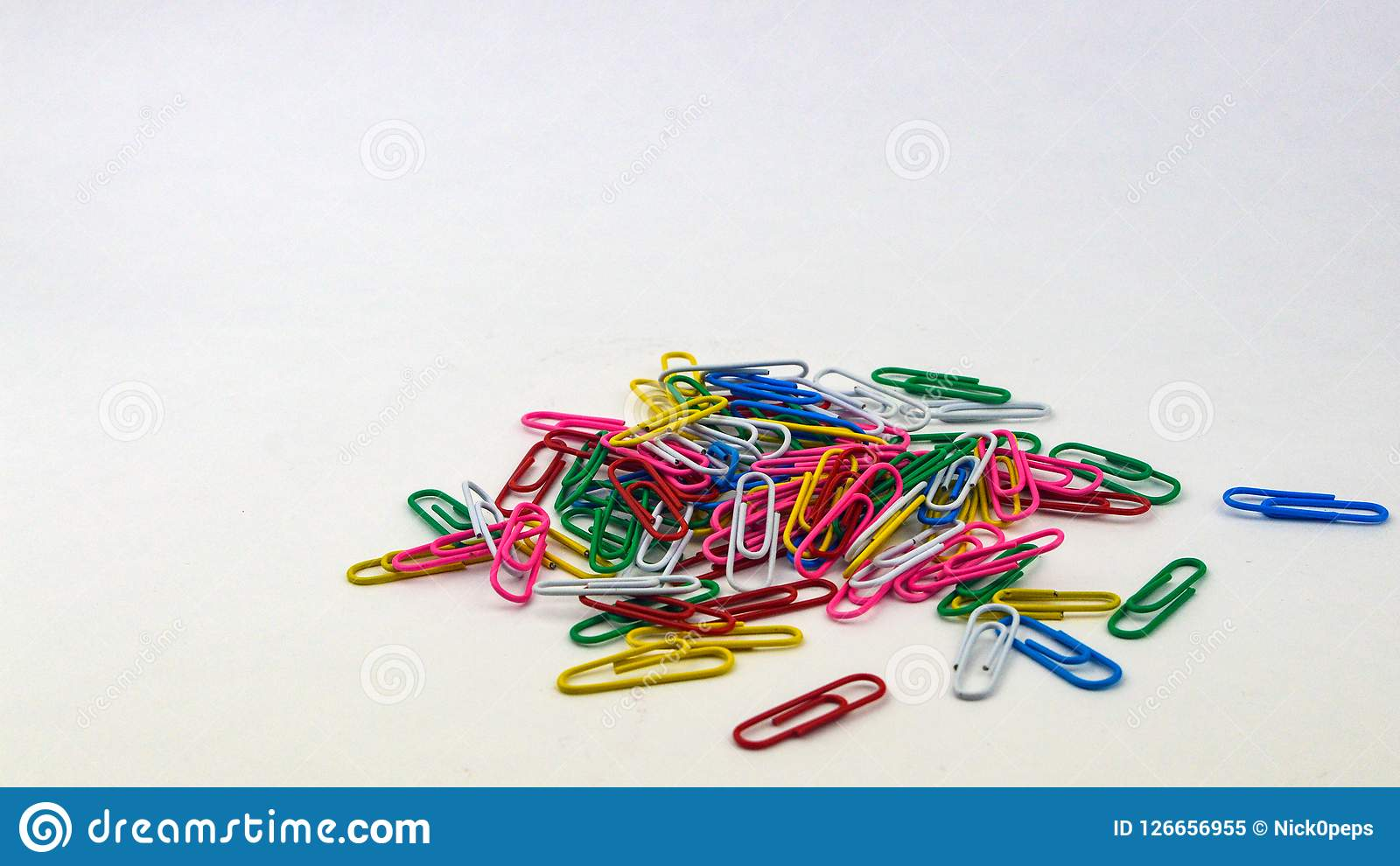 Lots of colorful paper clips on a white background