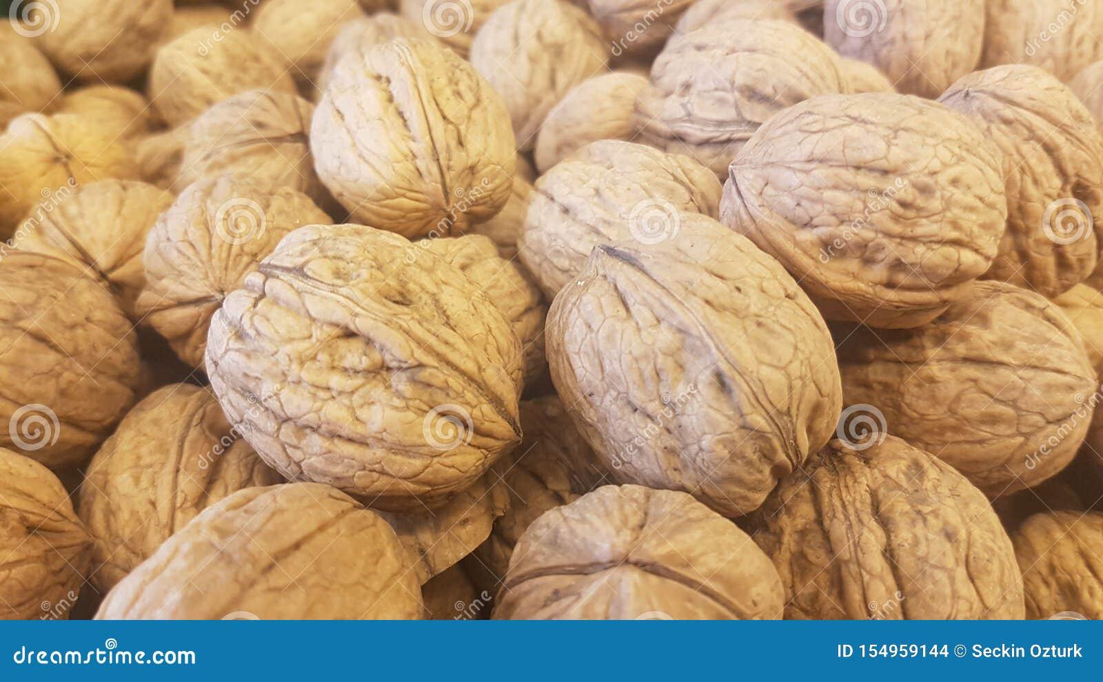 Lots of inshell walnuts texture