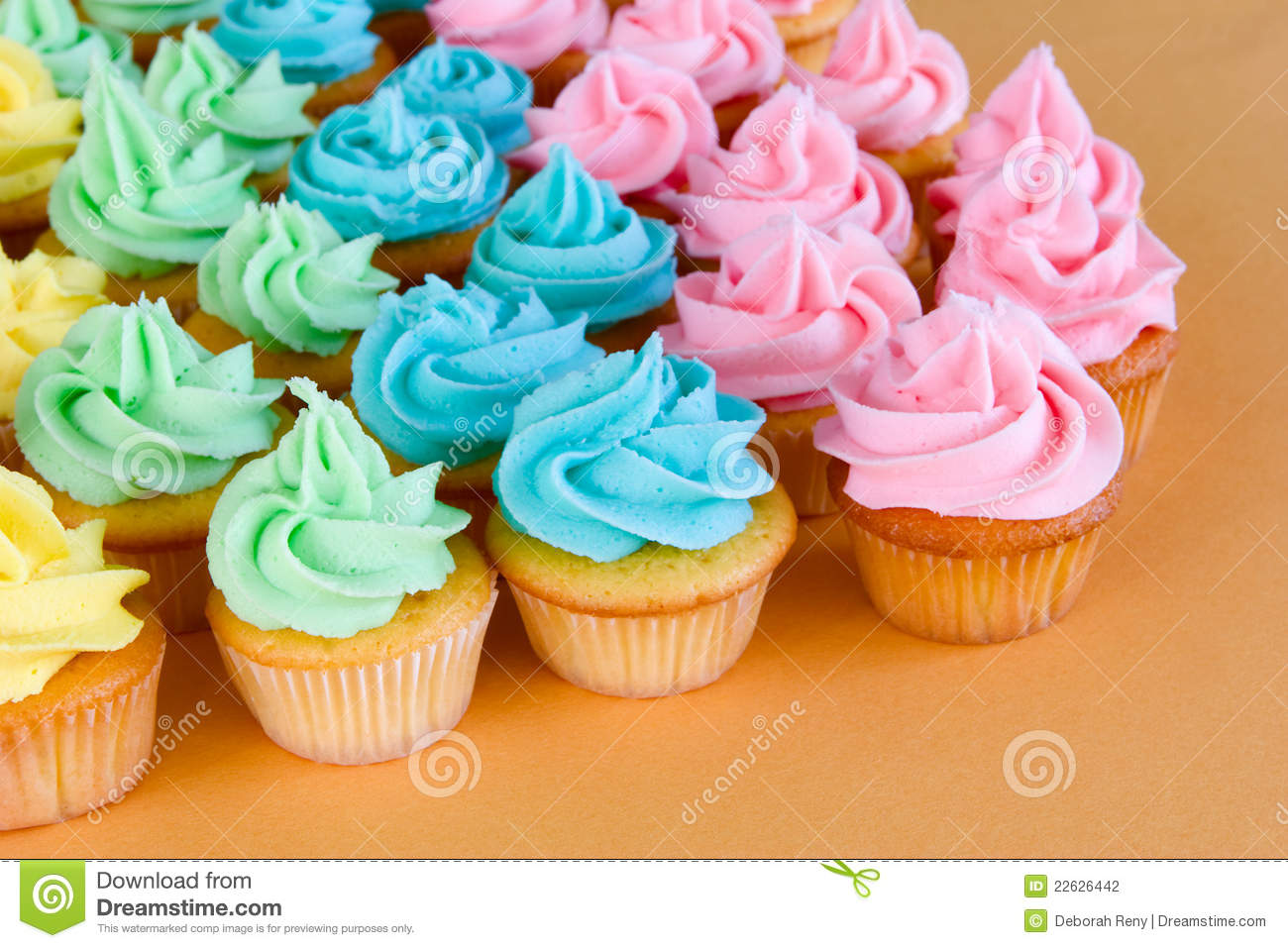 Lots of rainbow cupcakes stock photo. Image of festive ...
