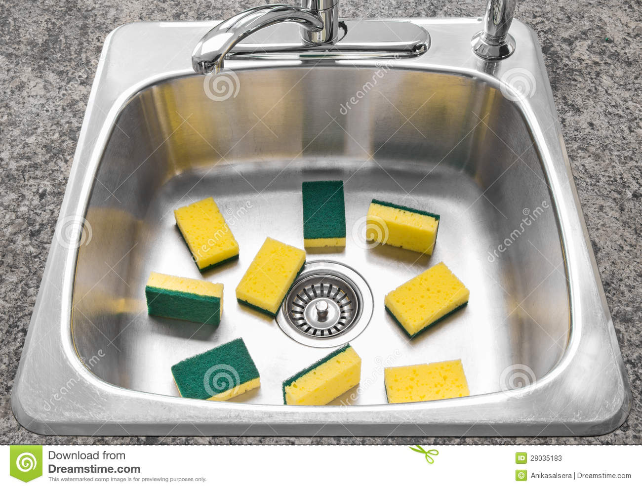 lots of yellow sponges in a clean kitchen sink stock photos