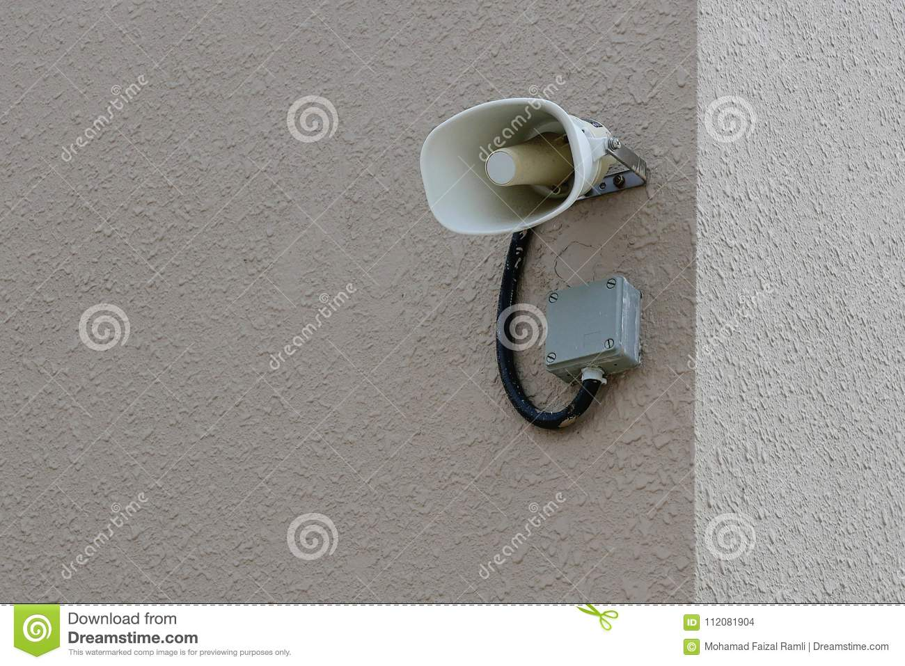 Loudspeaker or megaphone attached to wall. Copy space for text or logo