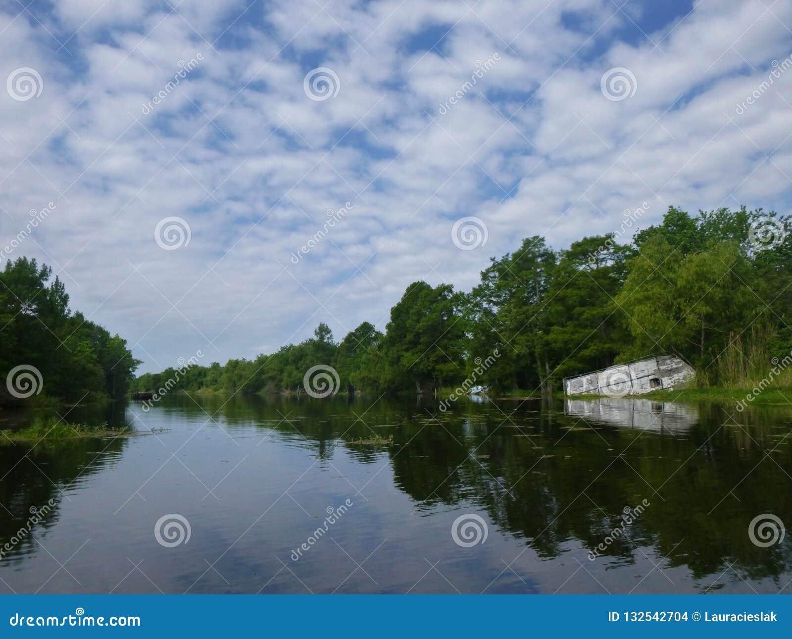 Louisiana swamp with an abandoned boat