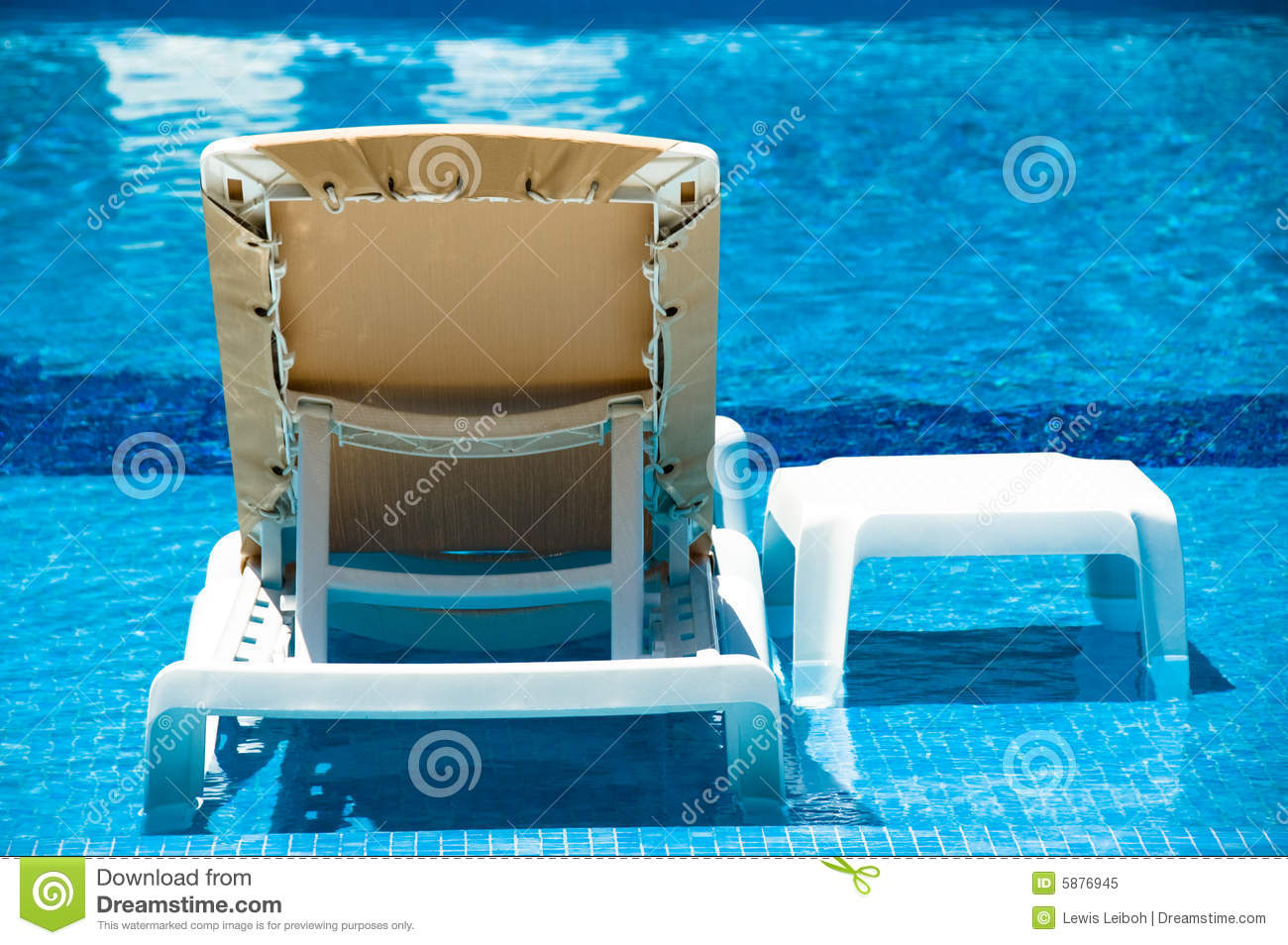 Lounge Chair In The Pool Royalty Free Stock Image
