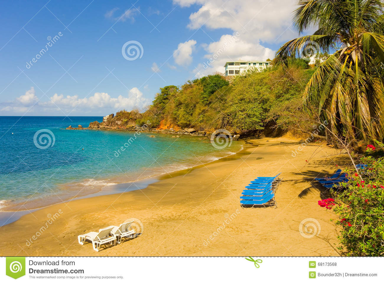 Lounge chairs on a beach in the windward islands stock for The windward