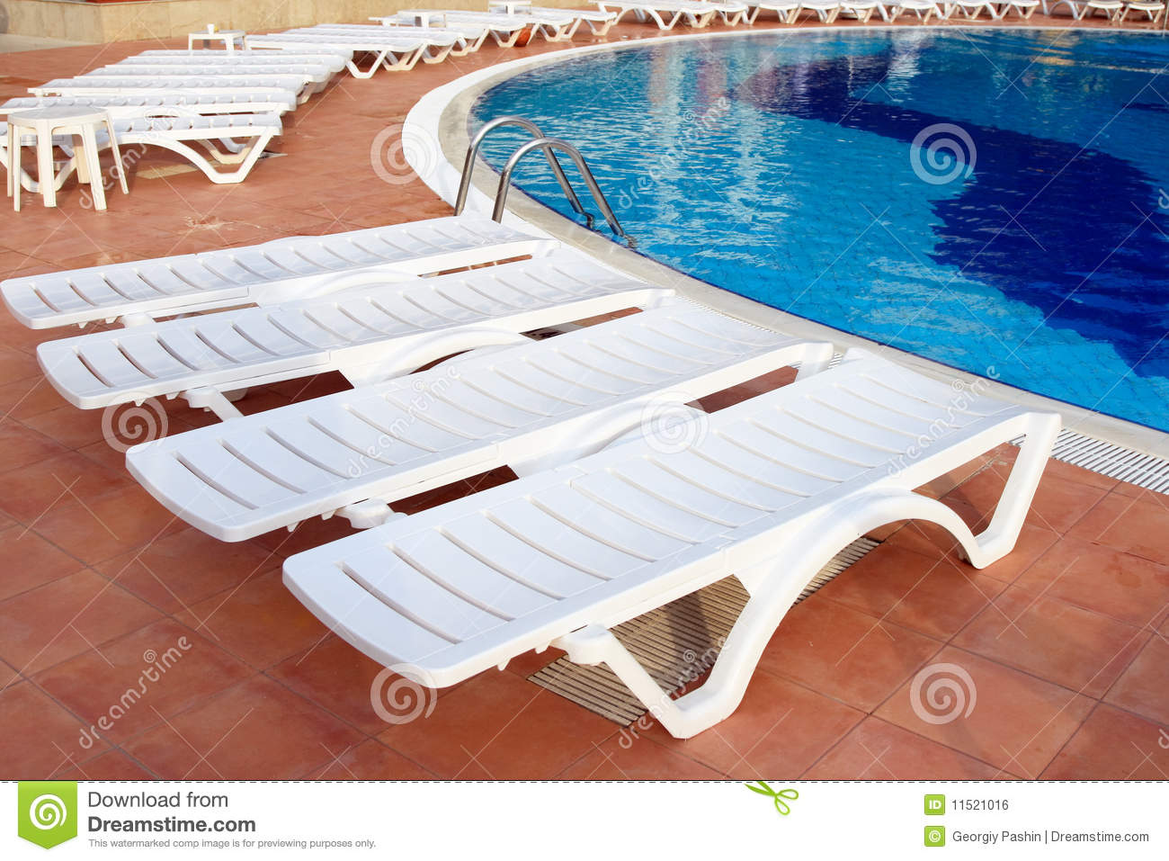 Lounge Chairs Near The Pool