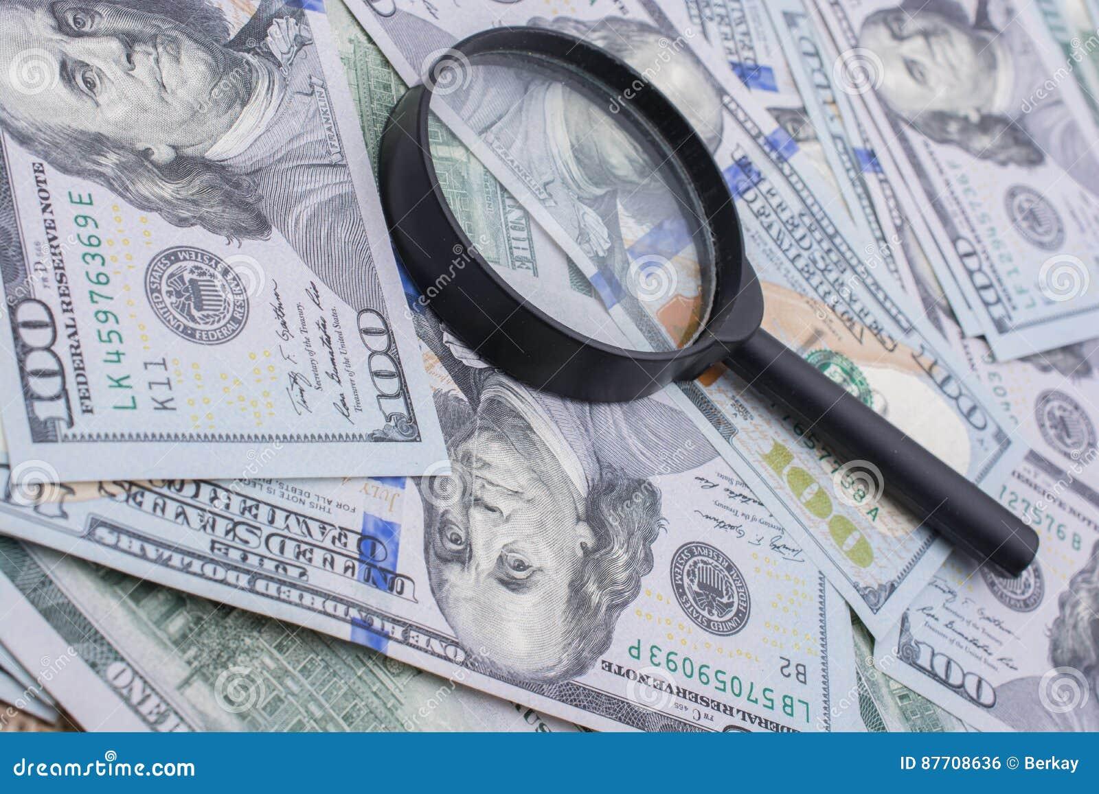 Loupe plus de dollar US les billets de banque