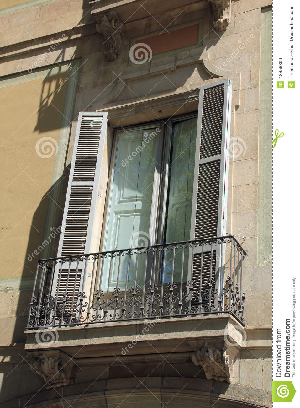 Louvre window with shutters in barcelona spain stock for Balcony louvres