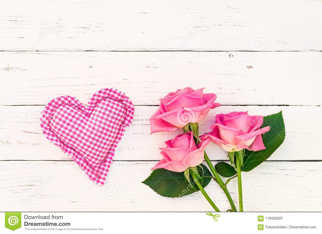 Love Background With Pink Bunch Of Roses And Heart On White Wood