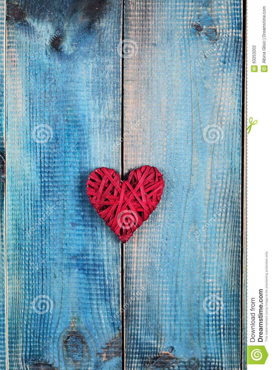 Love concept red heart over blue rustic wooden background for Rustic concept