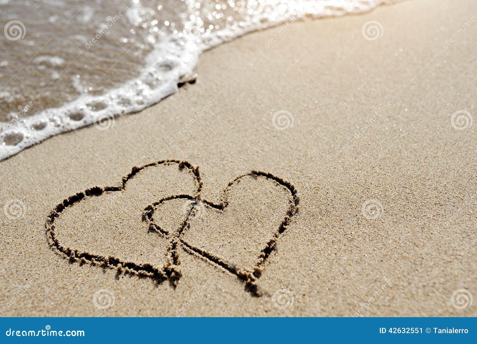Eu Te Amo Escrito Na Areia Imagens De Stock Royalty Free: Two Hearts Drawn On The Beach Sand Stock
