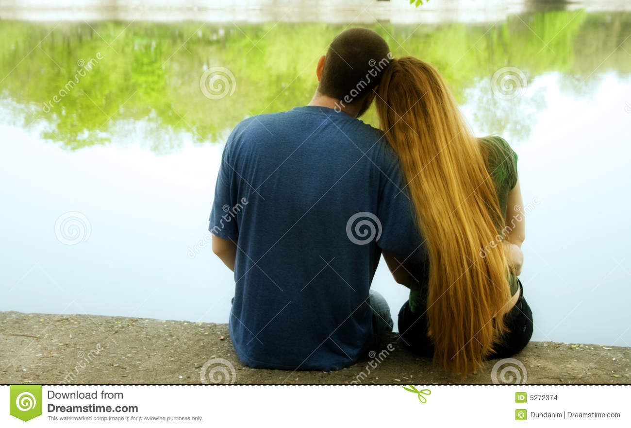 Love concept two lovers hugging near park lake stock for 2 lovers pic