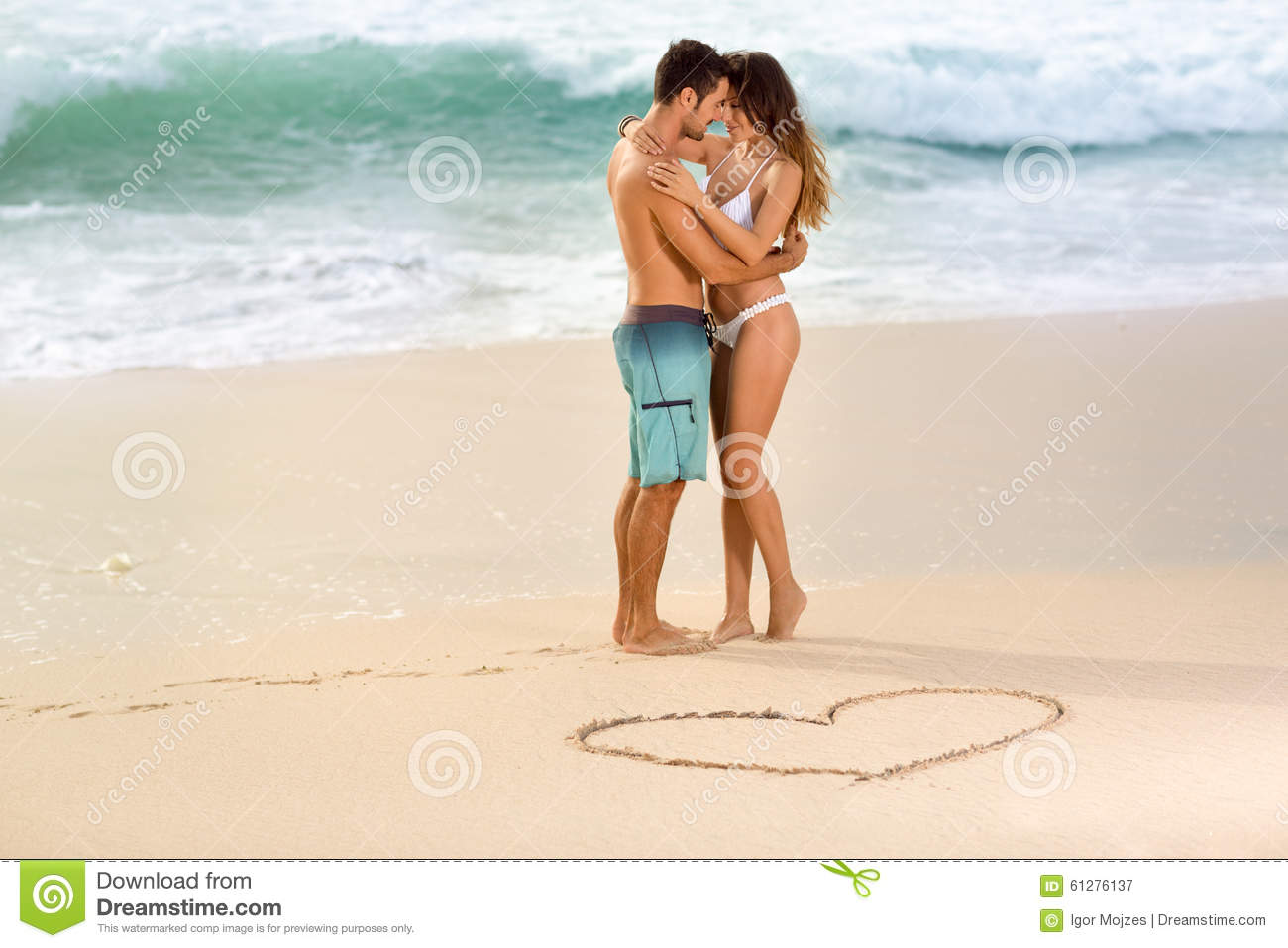 stock video love couple drawing beach