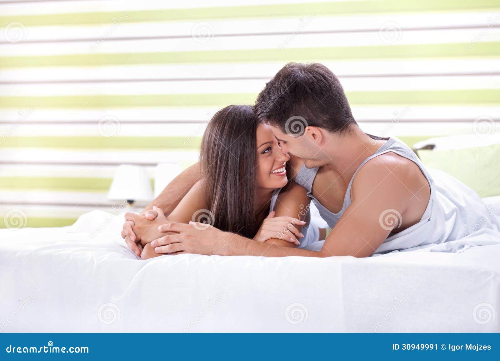 What Men Love In The Bedroom   cukjatidesign com cukjatidesign com Men Working On Laptop And Woman Reading Book In Bedroom Royalty