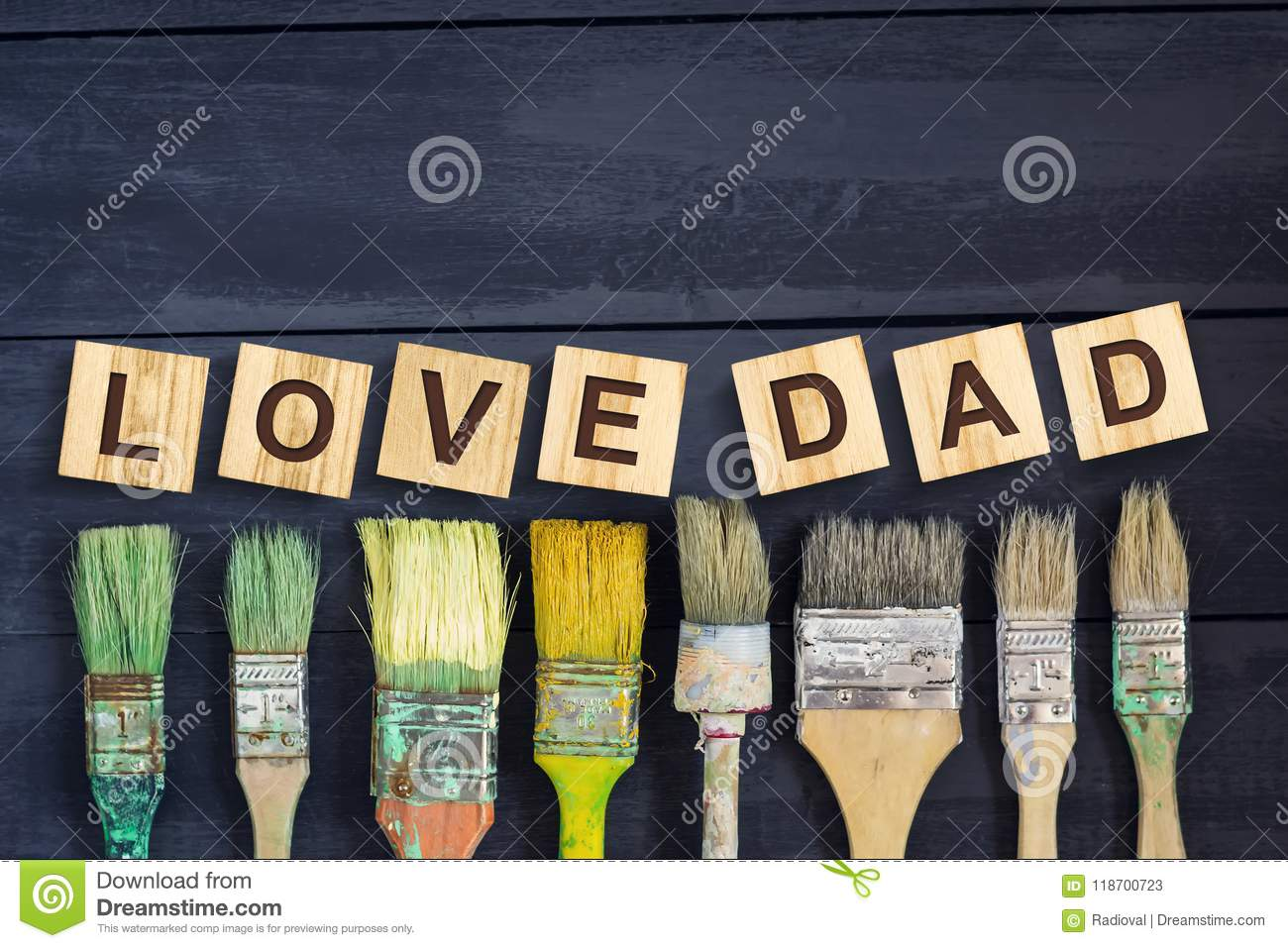 Love Dad Inscription On Wooden Cubes With Different Paint Brushes On