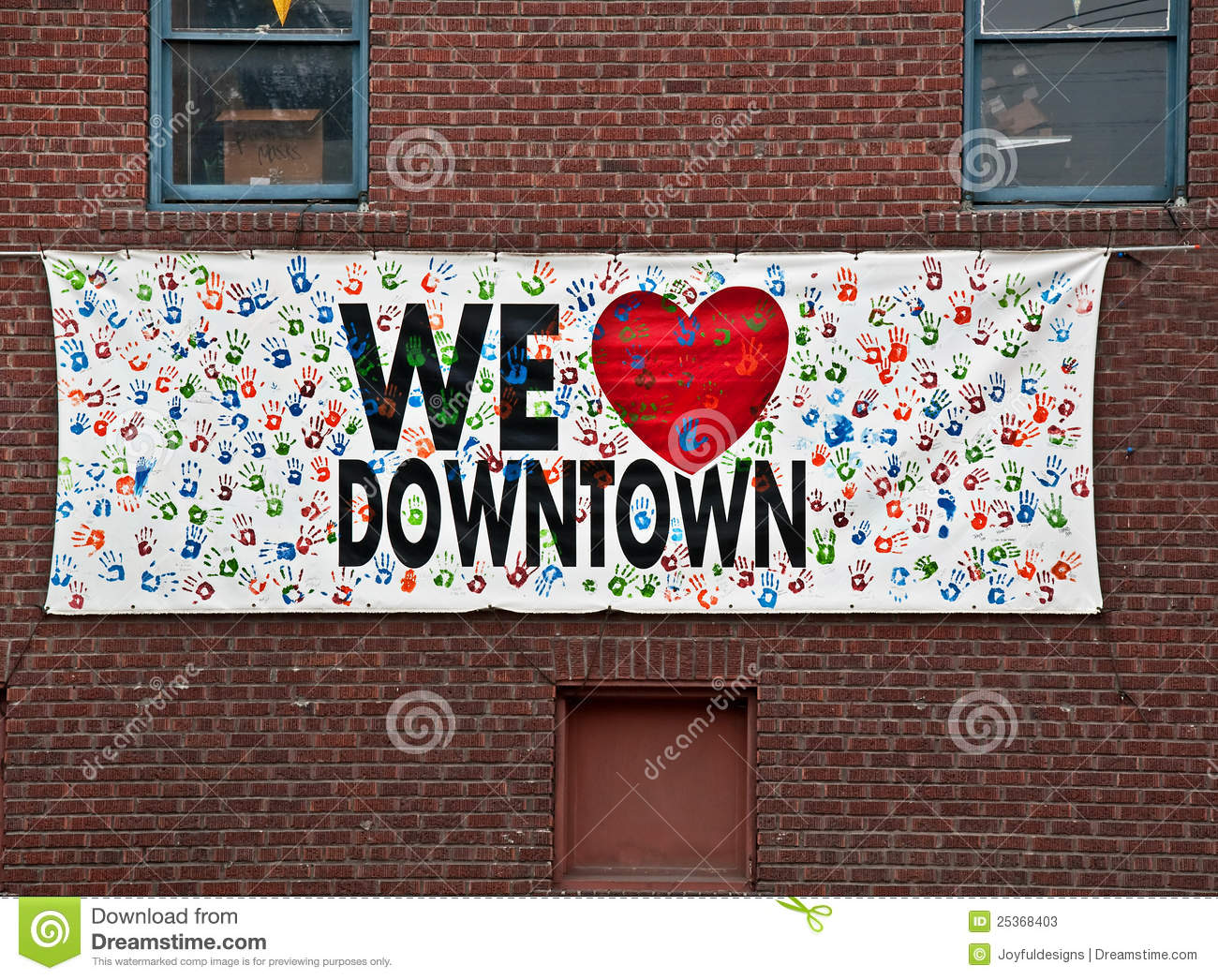 we love downtown sign on brick wall stock image