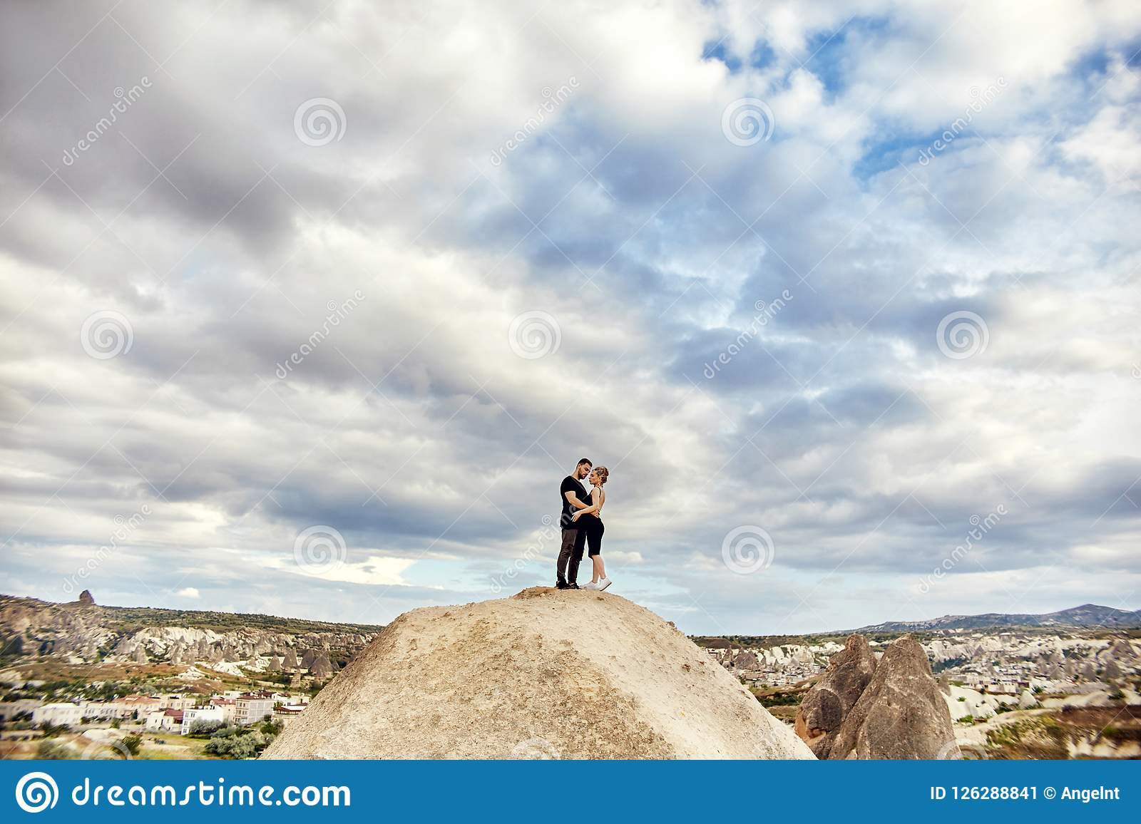 Love and emotions loving couple resting in Turkey. In love Eastern couple in the mountains of Cappadocia hugs and kisses. Close-up