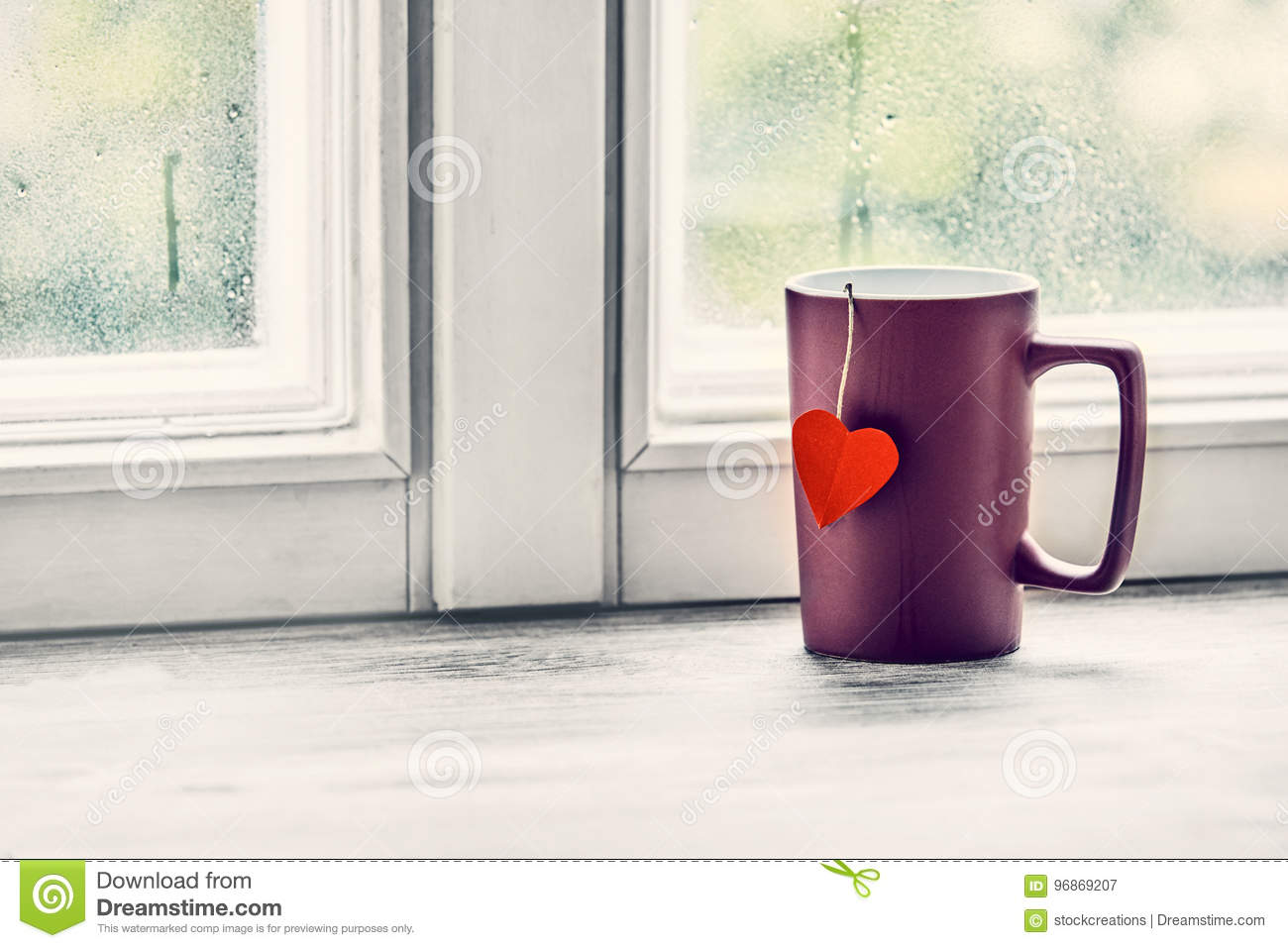 Love heart cup of tea on a bright window sill