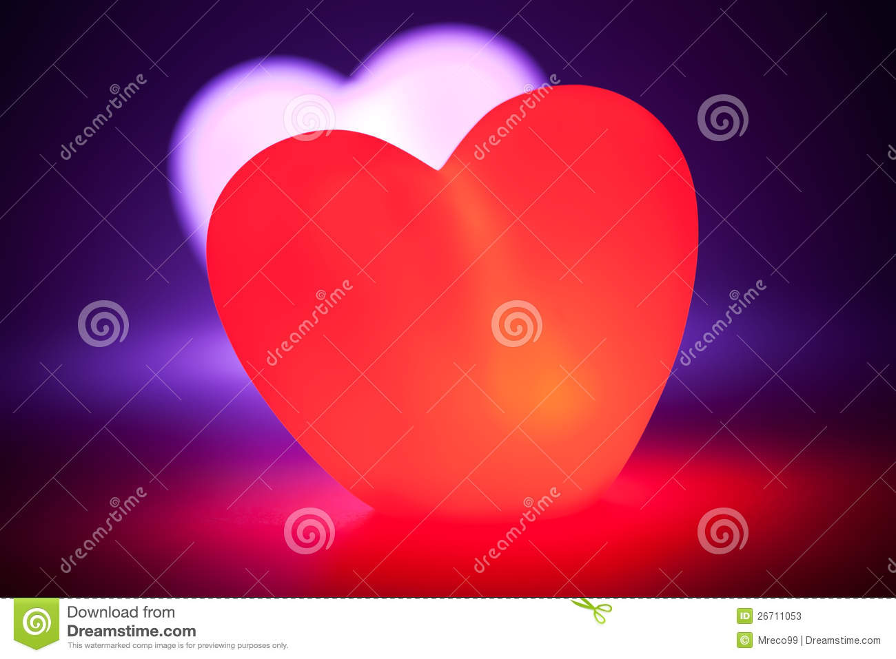Love heart glowing red with heart behind