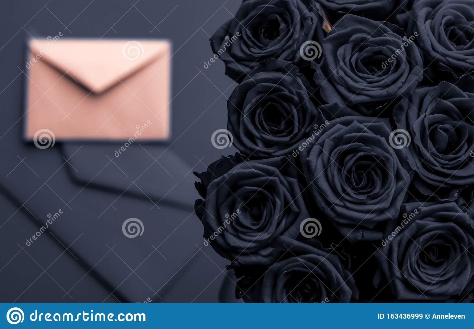Love letter and flowers delivery on Valentines Day, luxury bouquet of roses and card on charcoal background for romantic holiday