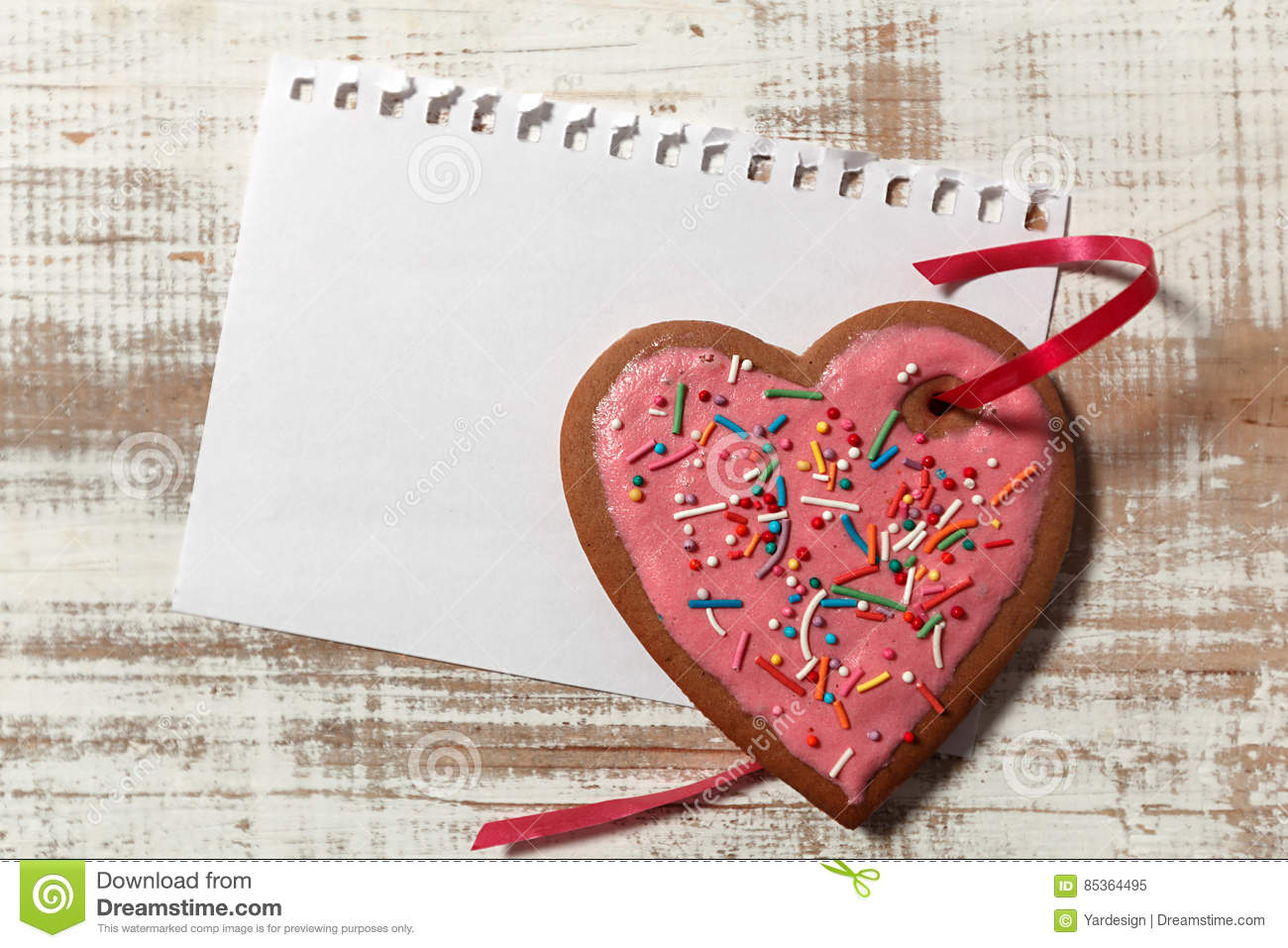 Love Letter Template On Paper And Cookie Heart With Red Ribbon On